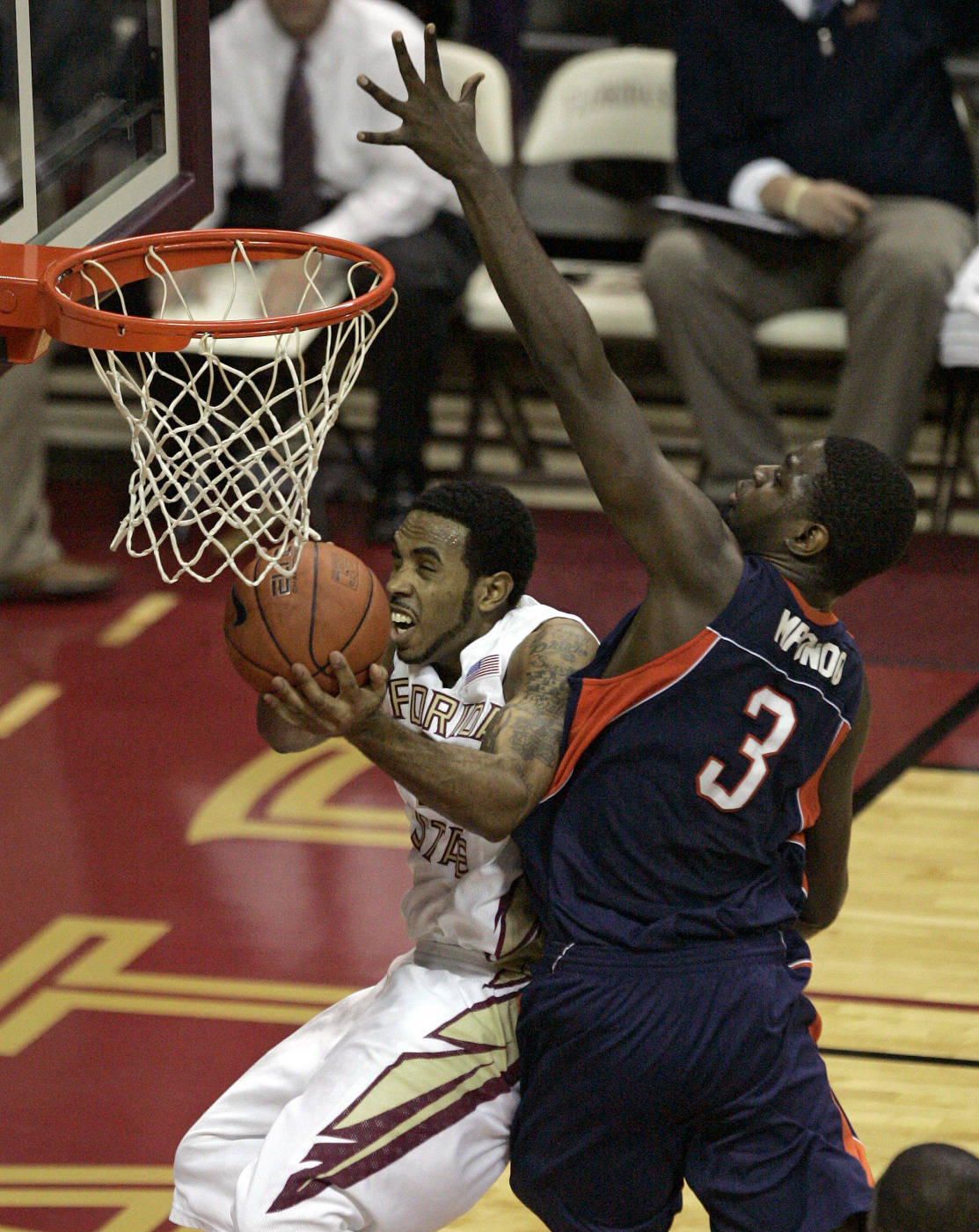 Florida State's Derwin Kitchen tries to drive around the defense of Tennessee-Martin's Dominique Mpondo during the first half of an NCAA college basketball game Tuesday, Dec. 22, 2009, in Tallahassee, Fla.
