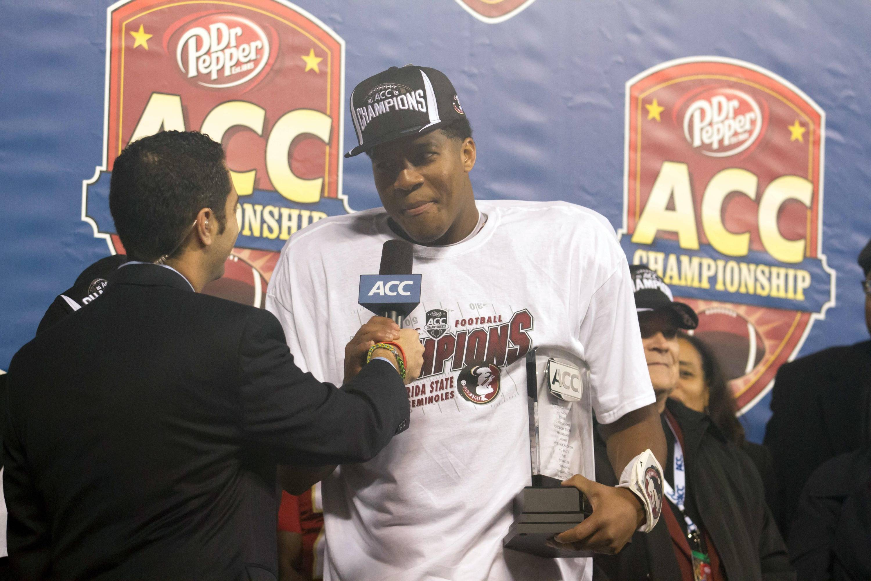 Dec 7, 2013; Charlotte, NC, USA; Florida State Seminoles quarterback Jameis Winston (5) accepts the ACC Championship Trophy after defeating the Duke Blue Devils at Bank of America Stadium. FSU defeated Duke 45-7. Mandatory Credit: Jeremy Brevard-USA TODAY Sports