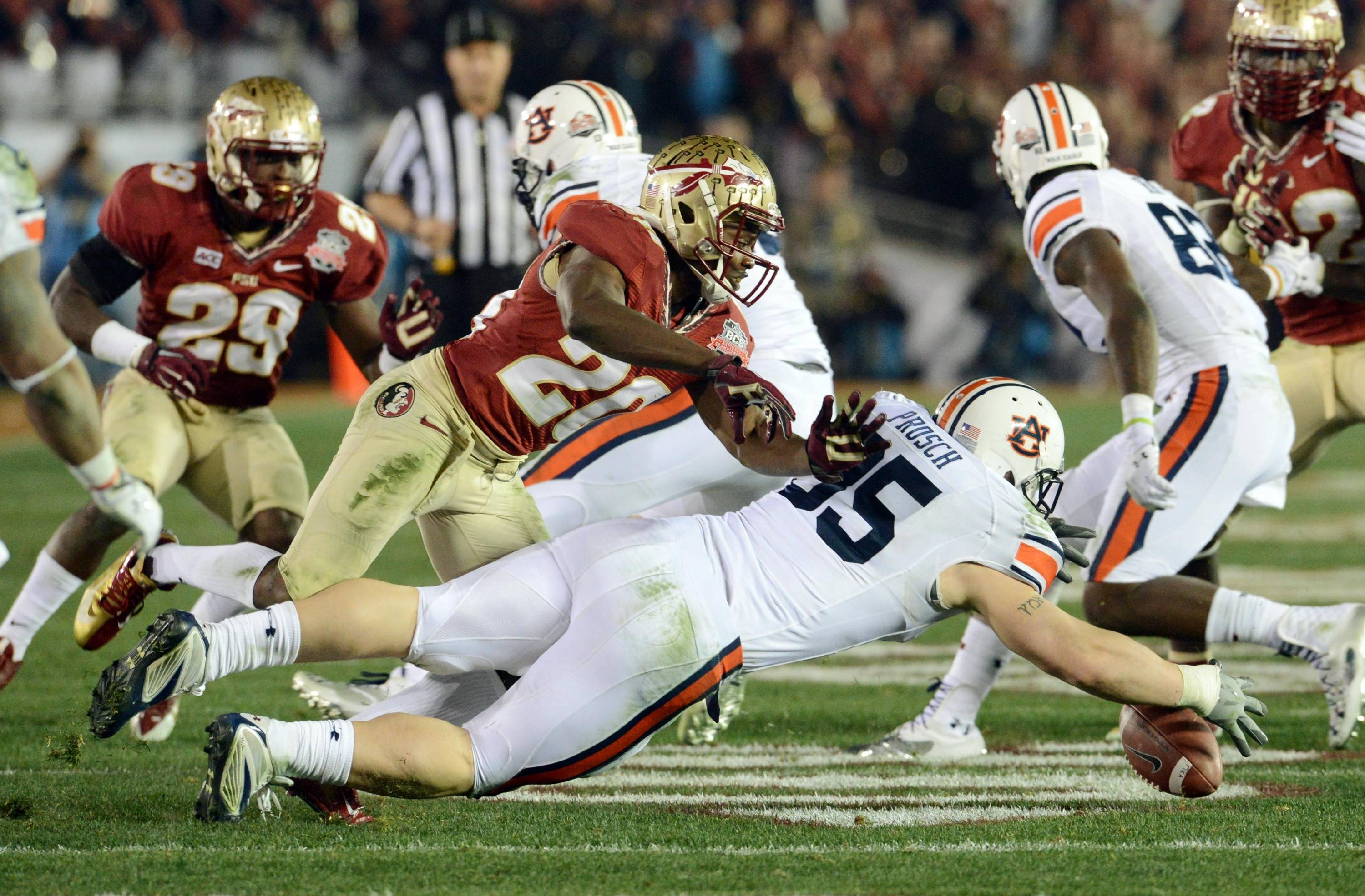 Jan 6, 2014; Pasadena, CA, USA; Auburn Tigers fullback Jay Prosch (35) dives for the ball while defended by Florida State Seminoles defensive back Lamarcus Joyner (20) during the second half of the 2014 BCS National Championship game at the Rose Bowl.  Mandatory Credit: Jayne Kamin-Oncea-USA TODAY Sports