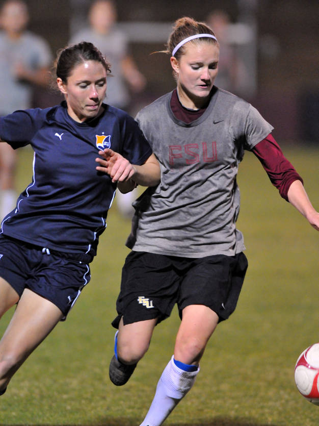 Sky Blue's Meghan Schnur and FSU's Susanna Zorn fight for possession of the ball.