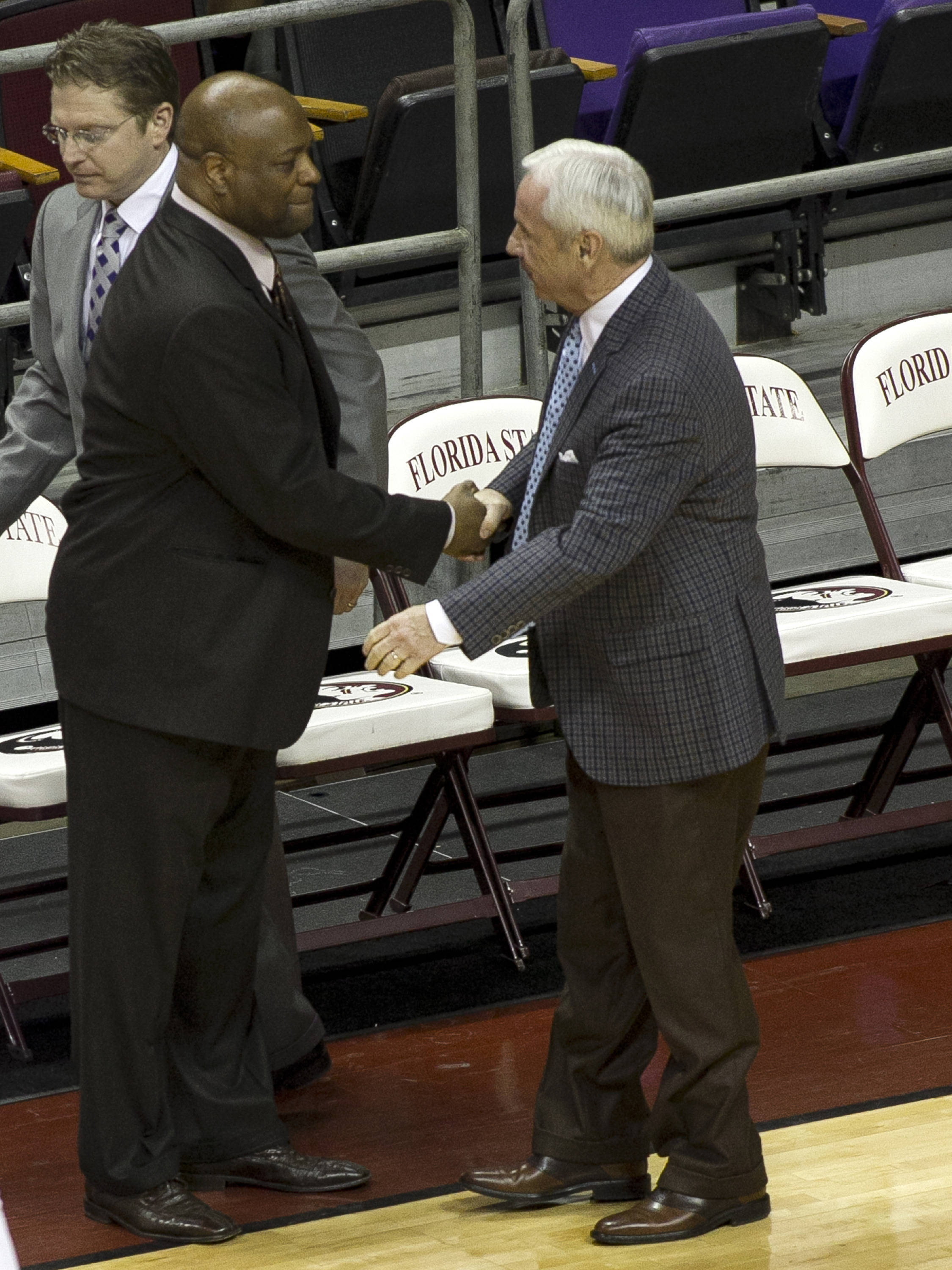 Head Coaches Leonard Hamilton and Roy Williams share a pre-game handshake, FSU vs North Carolina, 2-17-14, (Photo's by Steve Musco)