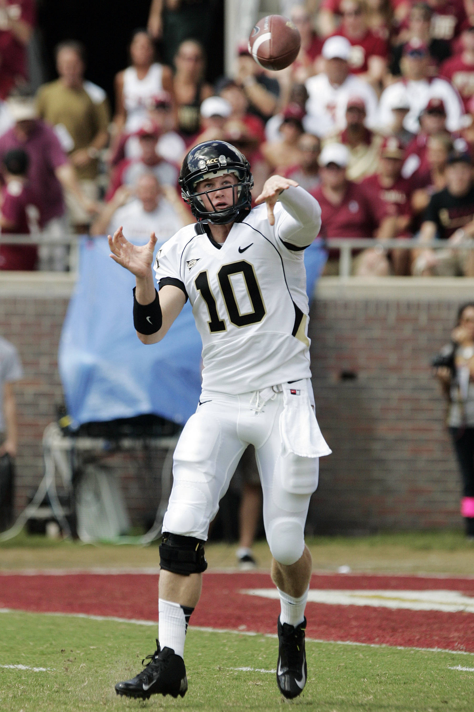 Wake Forest's Tanner Price attempts a pass against Florida State. (AP Photo/Steve Cannon)