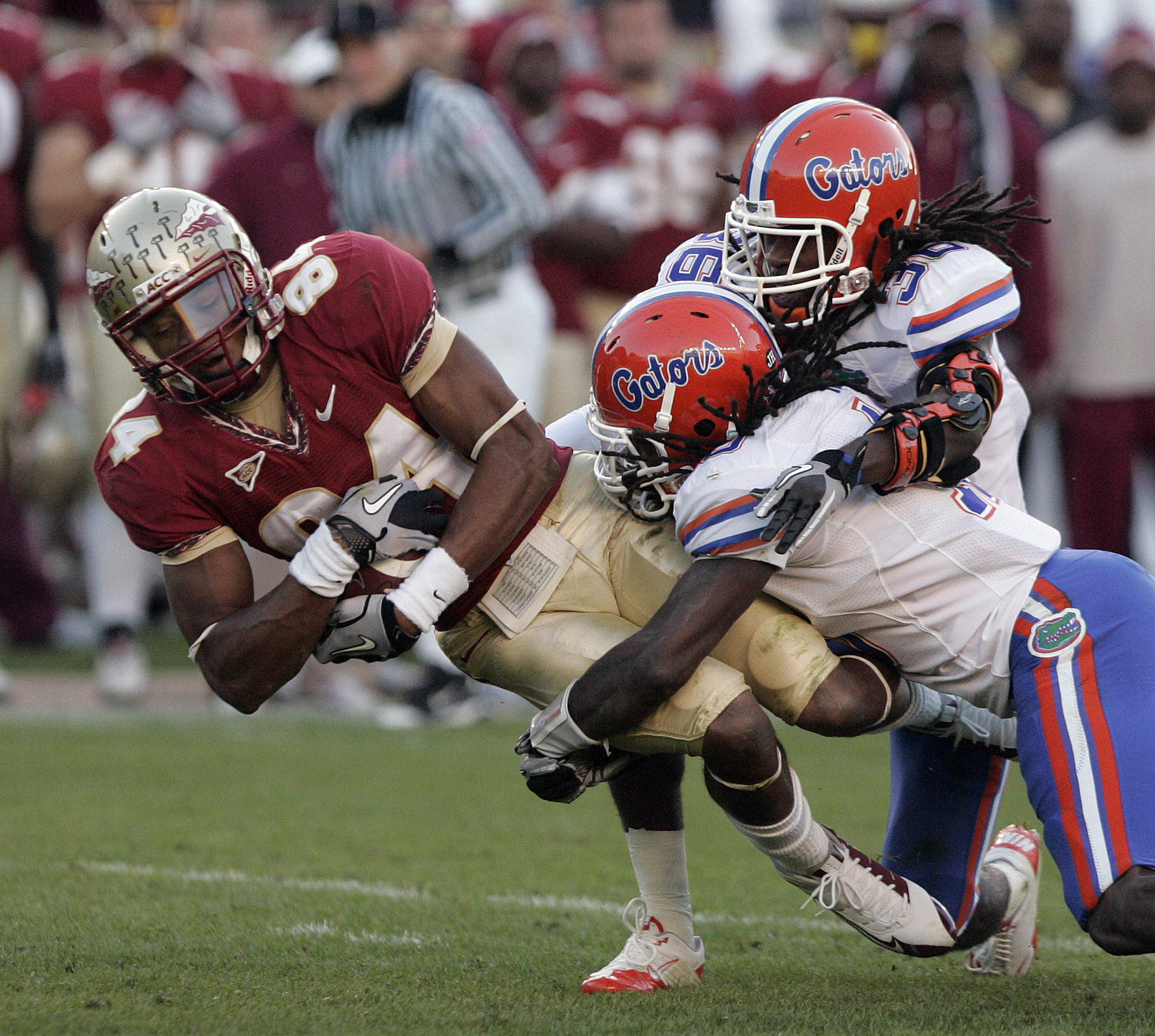 Florida State's Rodney Smith is tackled by Florida's Will Hill and Moses Jenkins, right, after making a reception in the second quarter of an NCAA college football game Saturday, Nov. 27, 2010, in Tallahassee, Fla.(AP Photo/Steve Cannon)