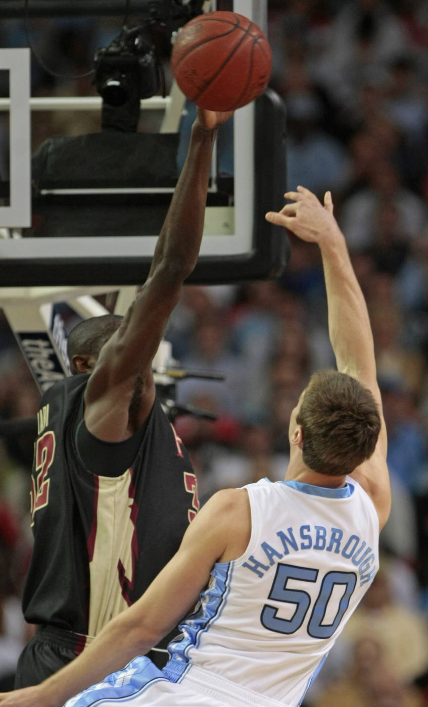 North Carolina forward Tyler Hansbrough (50) has his shot blocked by Florida State center Solomon Alabi (32) in first half action during an NCAA college basketball game in the semifinals of the Atlantic Coast Conference men's tournament in Atlanta, Saturday, March 14, 2009. (AP Photo/Dave Martin)