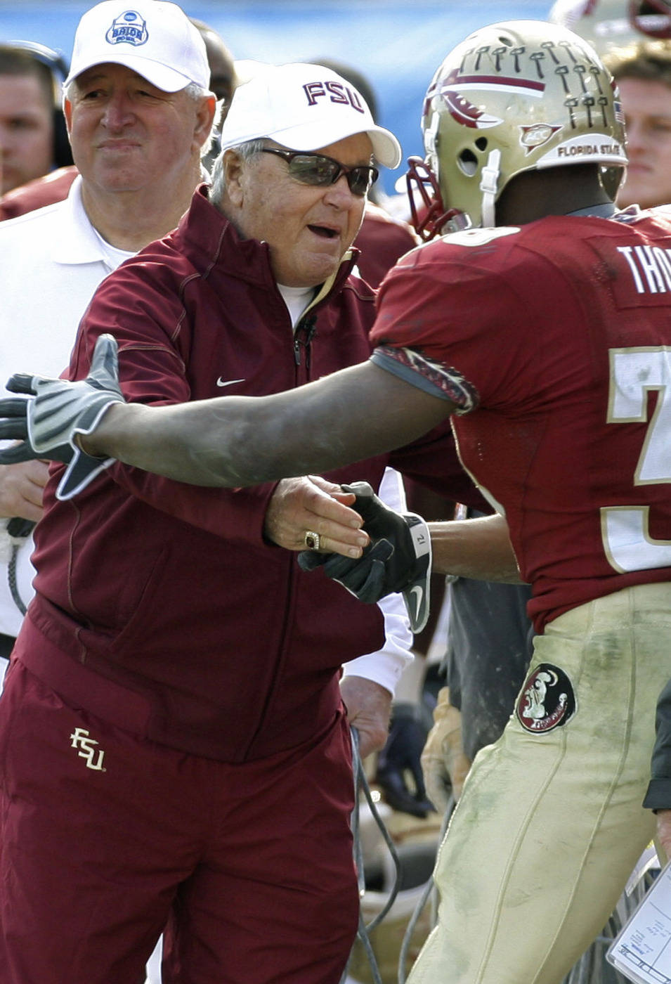 Florida State head coach Bobby Bowden, left, shakes hands with running back Jermaine Thomas during the third quarter of the Gator Bowl NCAA college football game against West Virginia after Thomas scored a touchdown, Friday, Jan. 1, 2010, in Jacksonville, Fla.  Florida State won 33-21, in Bowden's last game. (AP Photo/Phil Coale)