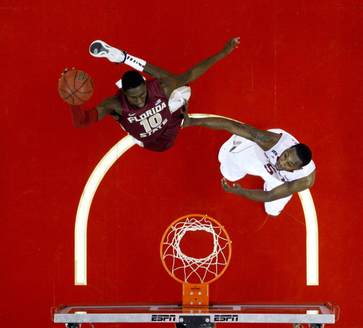 Florida State's Okaro White (10) dunks past North Carolina State's C.J. Leslie (5) in the second half of an NCAA college basketball game, Saturday, Feb. 18, 2012, in Raleigh, N.C. Florida State won 76-62. (AP Photo/The News & Observer, Ethan Hyman) MANDATORY CREDIT