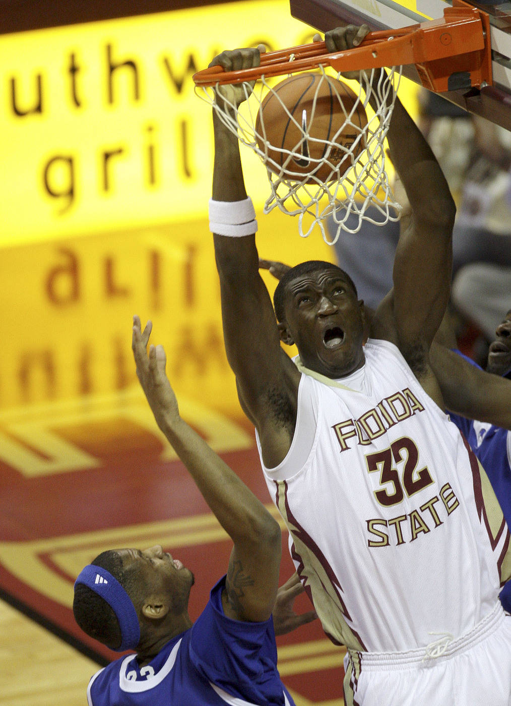 Florida State's Solomon Alabi scores over Georgia State's Xavier Hansbro during the first half of an NCAA college basketball game, Tuesday, Dec. 15, 2009, in Tallahassee, Fla.(AP Photo/Phil Coale)
