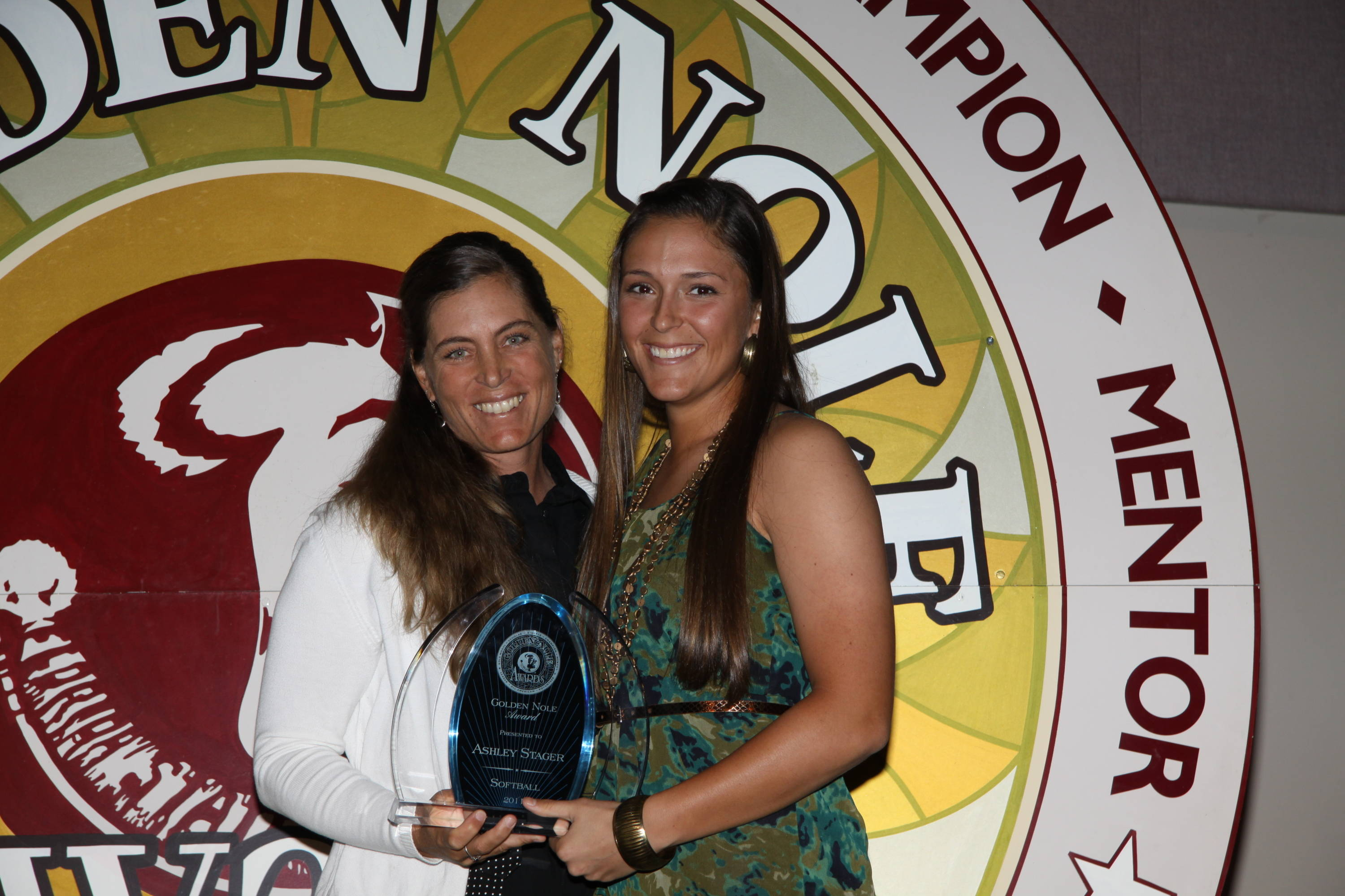 Head coach Lonni Alameda poses with senior Ashley Stager after Stager was named an ACC Top Six for Service winner