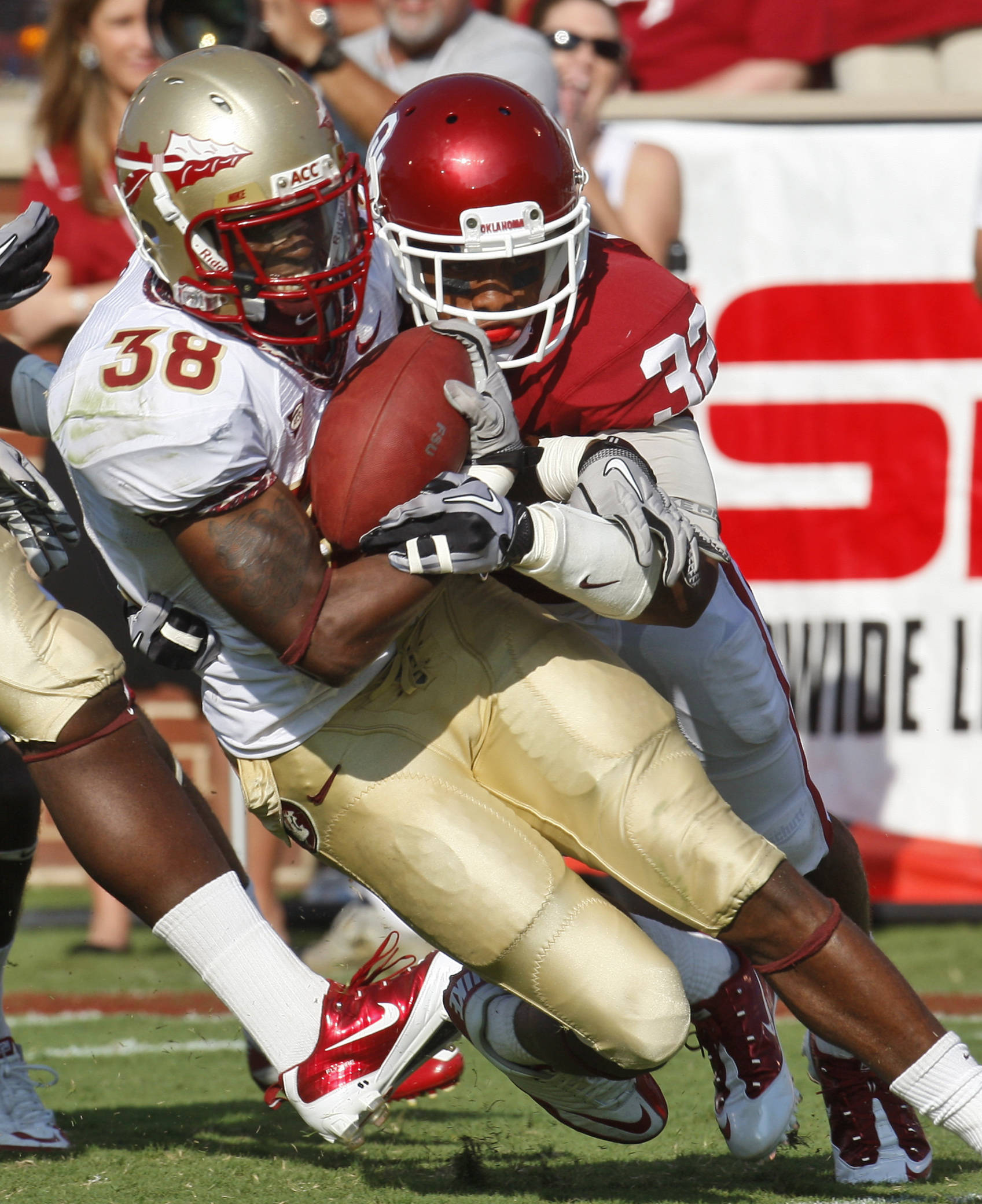 Florida State running back Jermaine Thomas, left, is brought down by Oklahoma cornerback Jamell Fleming, right, in the third quarter. (AP Photo/Sue Ogrocki)