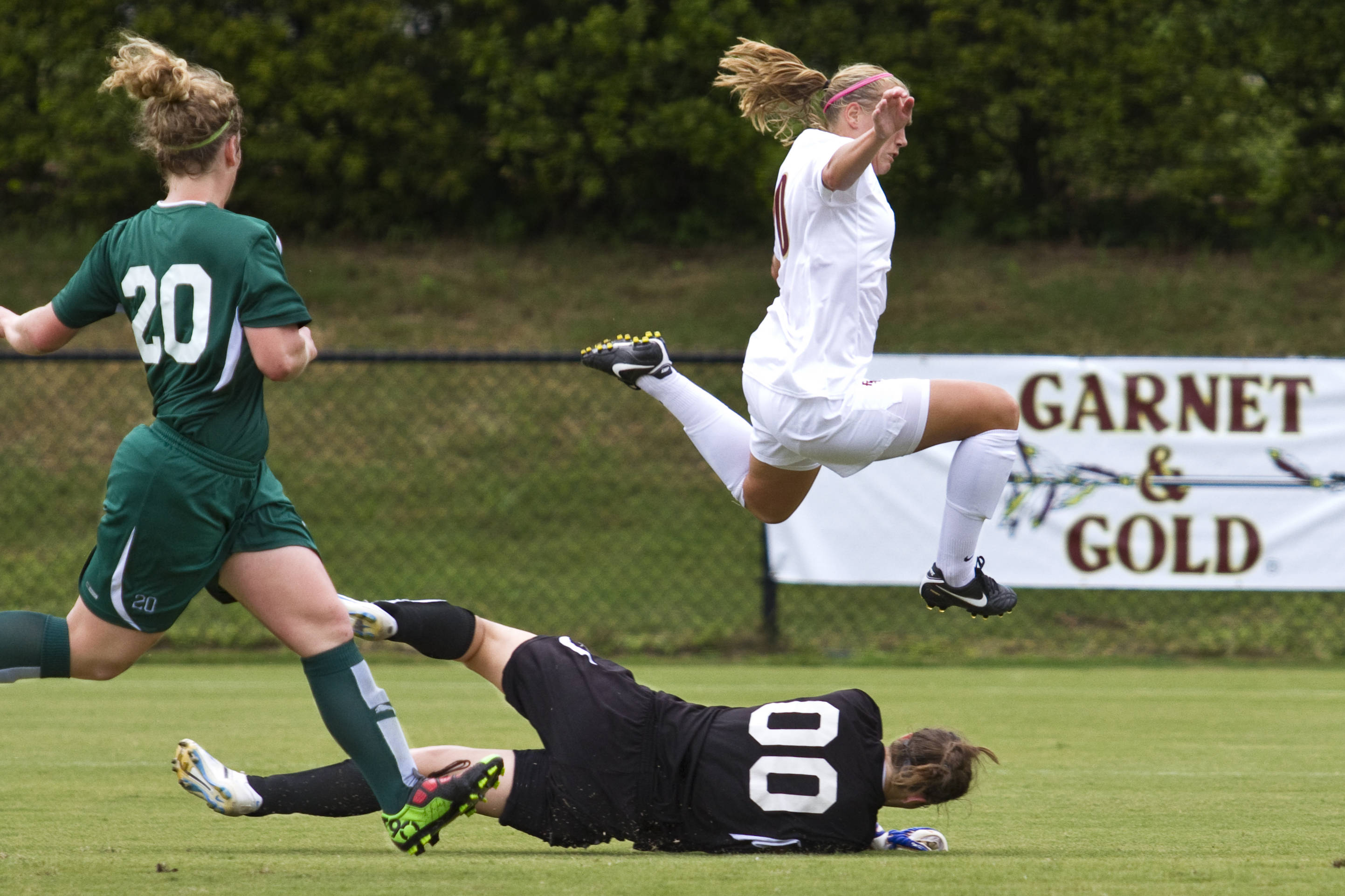 Janice Cayman (20) leaps over the keeper for Stetson.