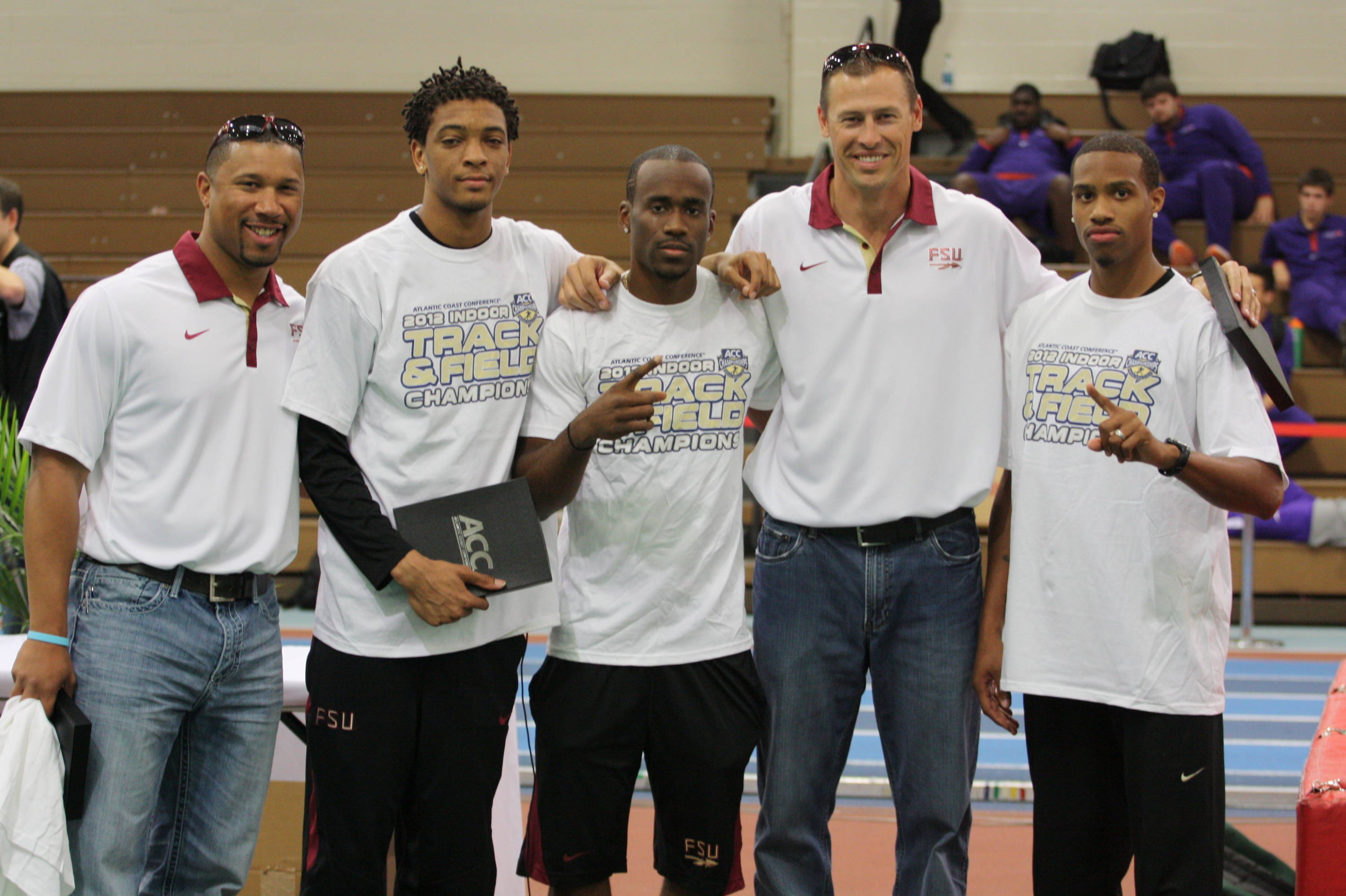 FSU's sprint posse of Stephen Newbold, Kemar Hyman and Maurice Mitchell swept the three ACC sprint titles. They are joined by assistant Devin West (left) and director of sprints, hurdles and relays Ken Harnden (second from right).