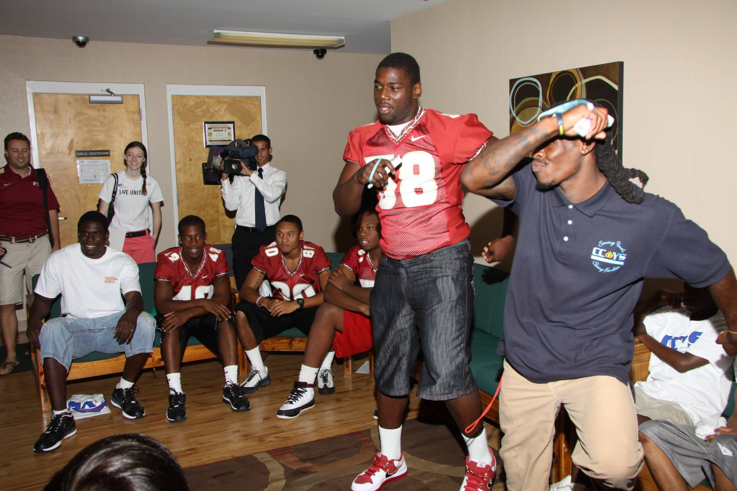 2011 FSU Football players out in the community performing community service.