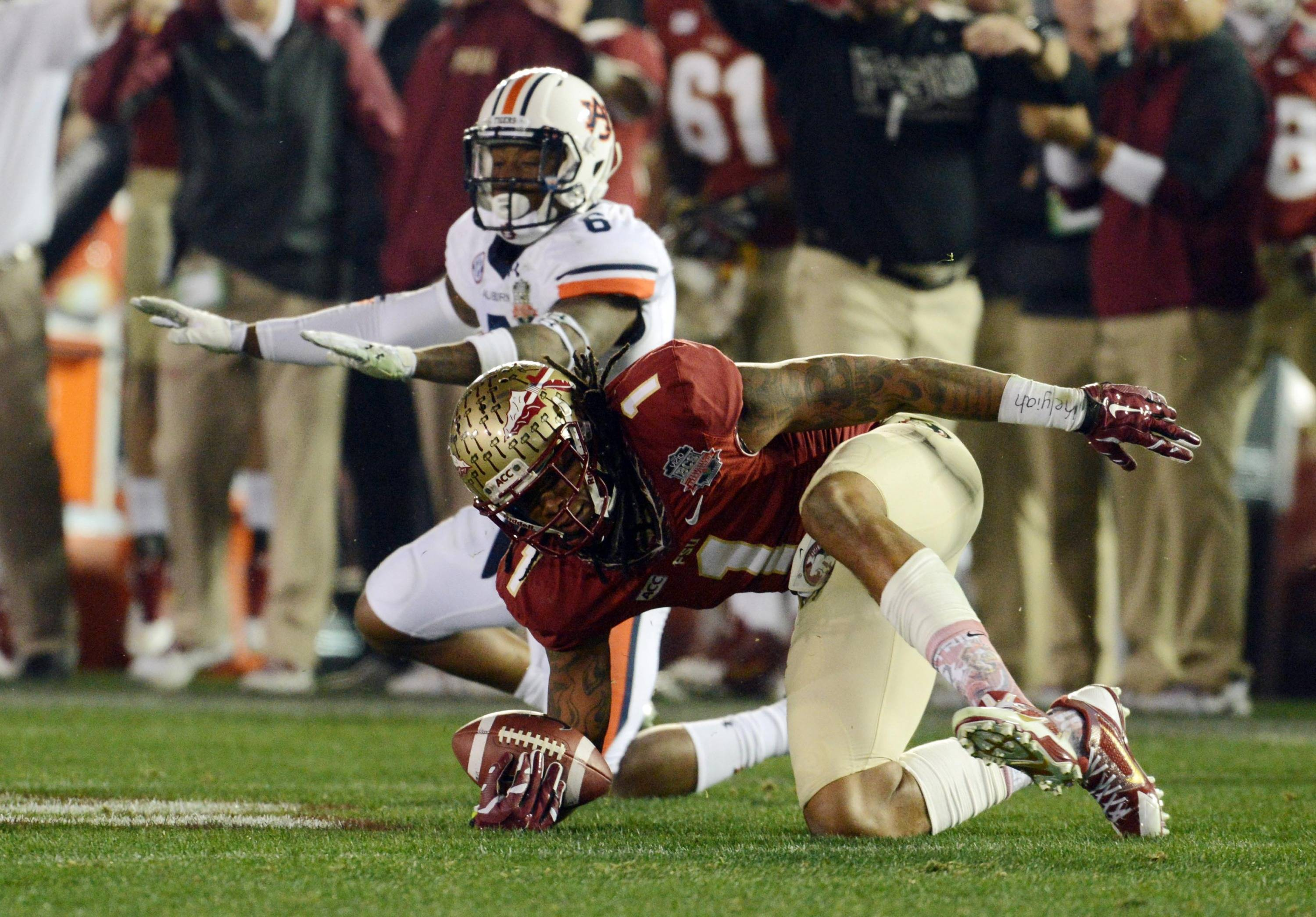 Jan 6, 2014; Pasadena, CA, USA; Florida State Seminoles wide receiver Kelvin Benjamin (1) reacts after being tackled by Auburn Tigers defensive back Jonathon Mincy (6) during the second half of the 2014 BCS National Championship game at the Rose Bowl.  Mandatory Credit: Jayne Kamin-Oncea-USA TODAY Sports