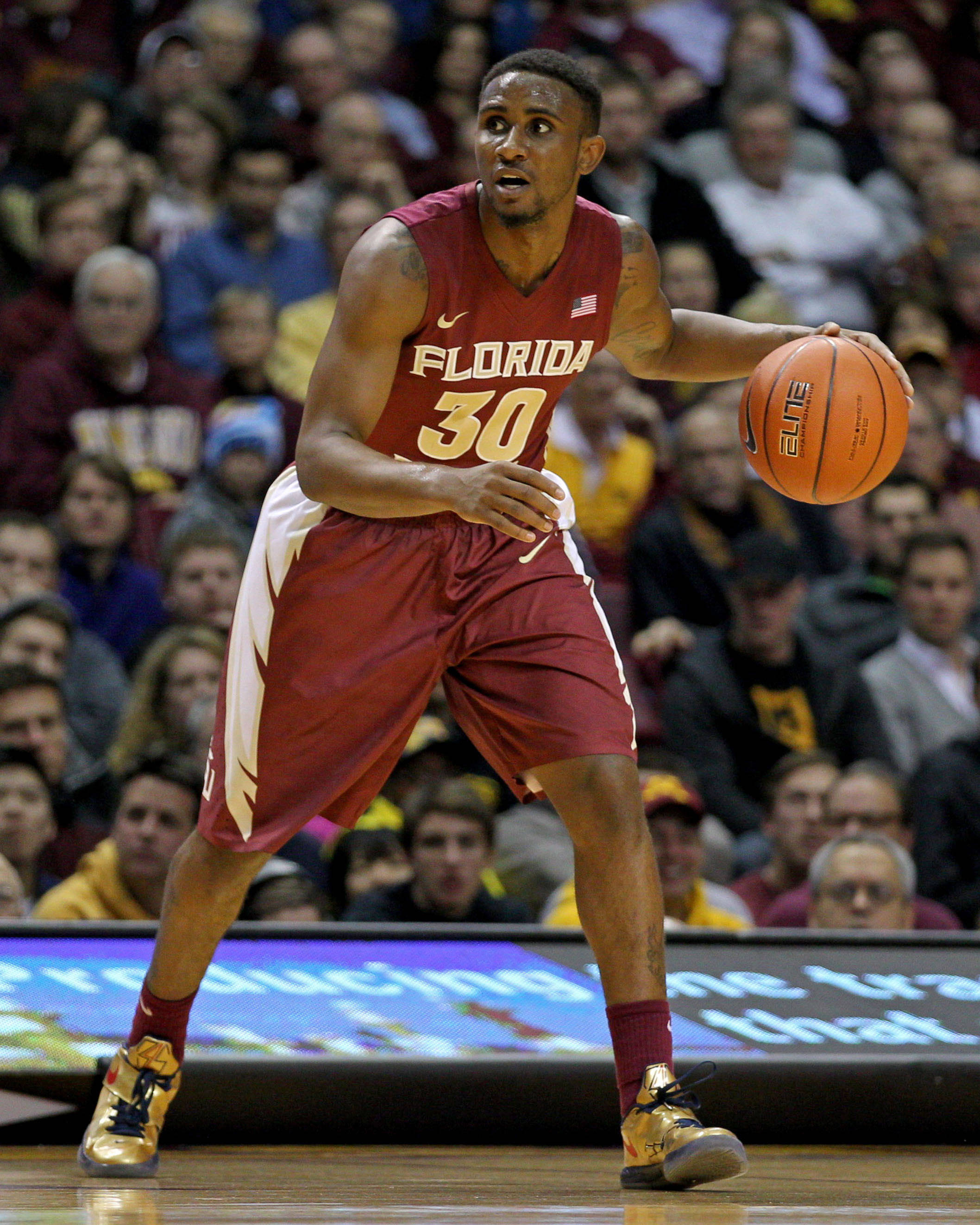 Dec 3, 2013; Minneapolis, MN, USA; Florida State Seminoles guard Ian Miller (30) dribbles during the first half against the Minnesota Golden Gophers at Williams Arena. Mandatory Credit: Brace Hemmelgarn-USA TODAY Sports