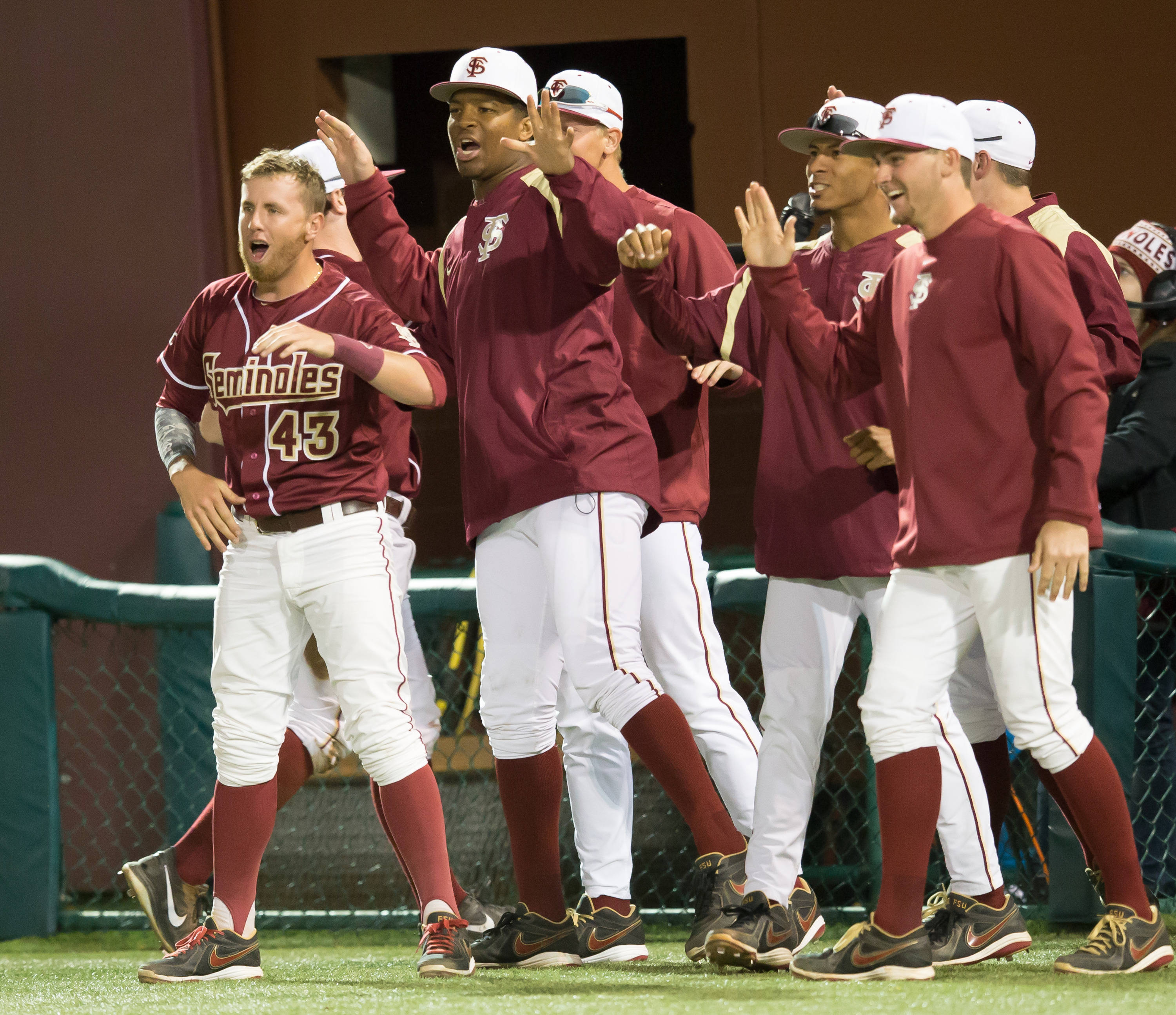 The Noles bench celebrates an inning ending double play in the bottom of the 7th.