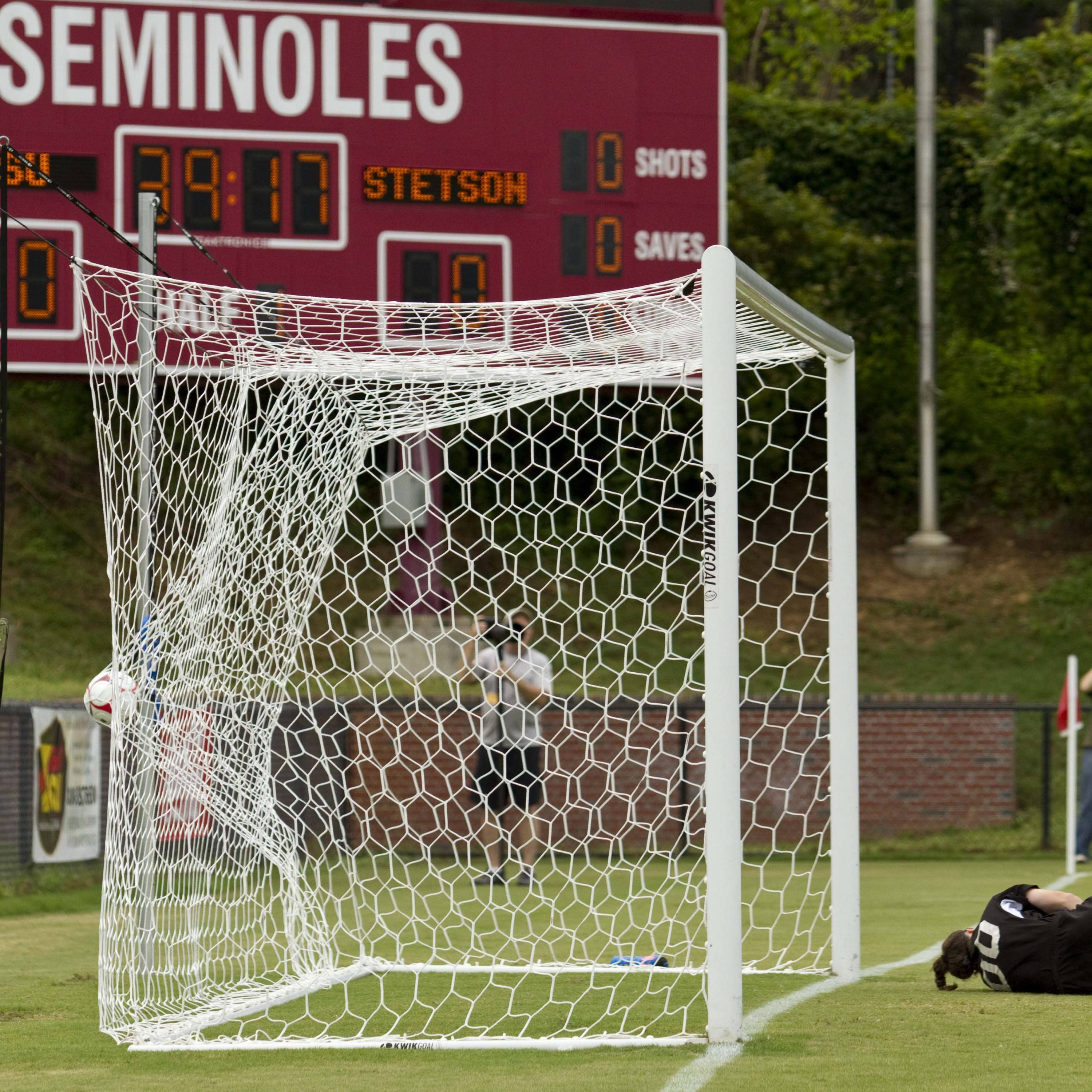 The game ball hits the net as the Seminoles score the first goal of the game.