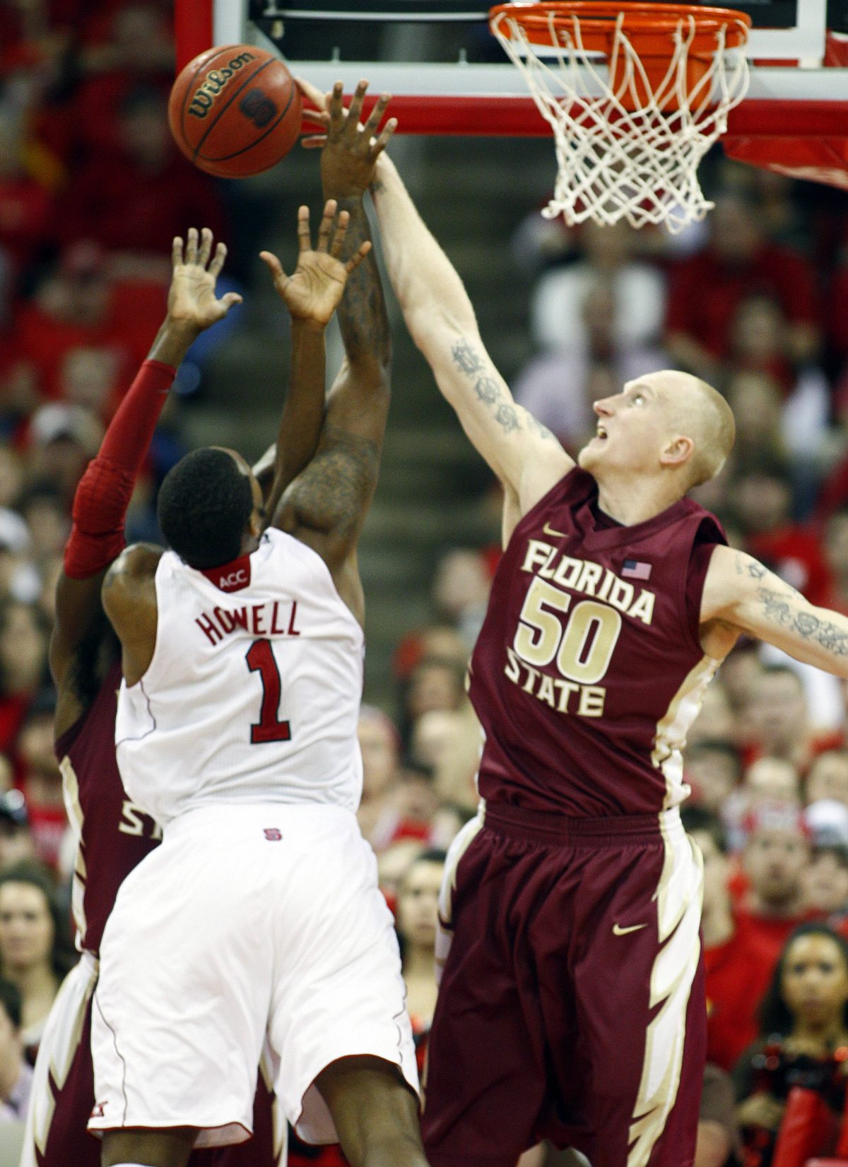 Florida State's Jon Kreft (50) blocks the shot of North Carolina State's Richard Howell (1) during the second half of an NCAA college basketball game in Raleigh, N.C., Saturday, Feb. 18, 2012. Florida State won 76-62. (AP Photo/Karl B DeBlaker)