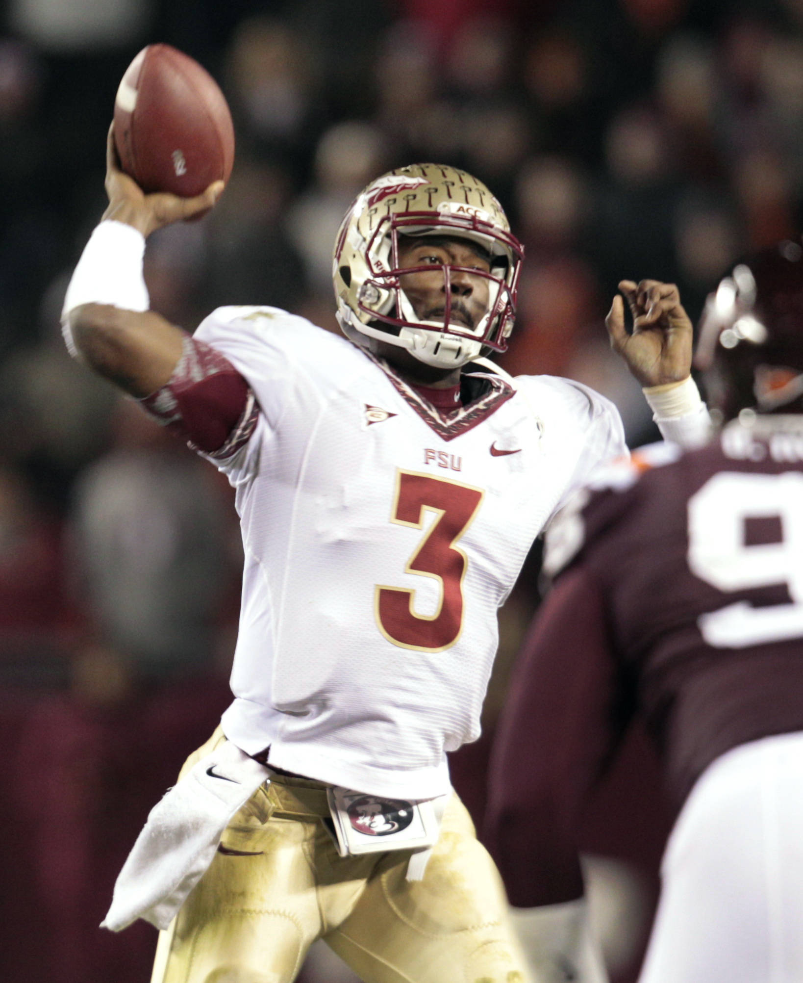 Florida State quarterback EJ Manuel passes during the first half. (AP Photo/Steve Helber)