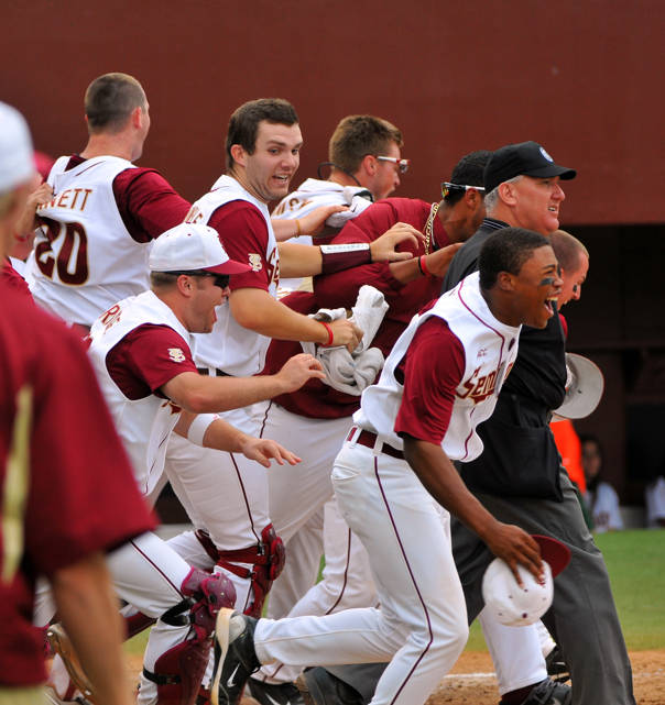 The Seminoles storming out of the dugout after Tapley's game-winning hit in the ninth.