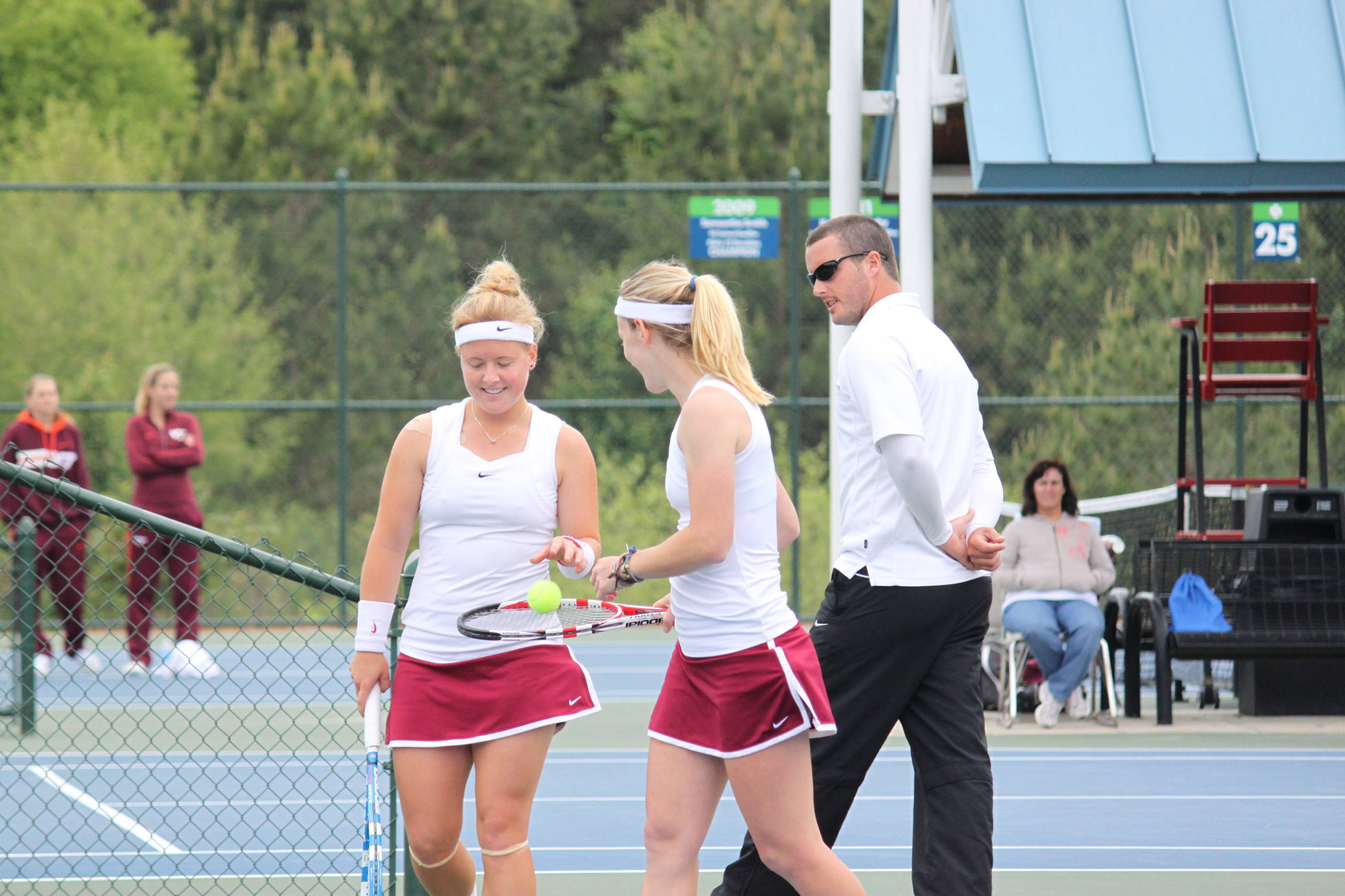 Ruth and Amy get instructions from Coach Oliver Foreman