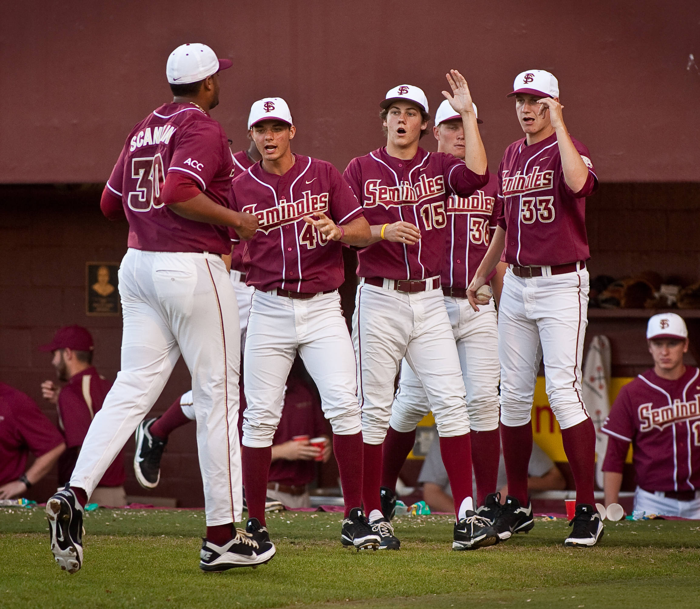 Teammates congratulate Hunter Scantling (30) after his shutout 7th inning