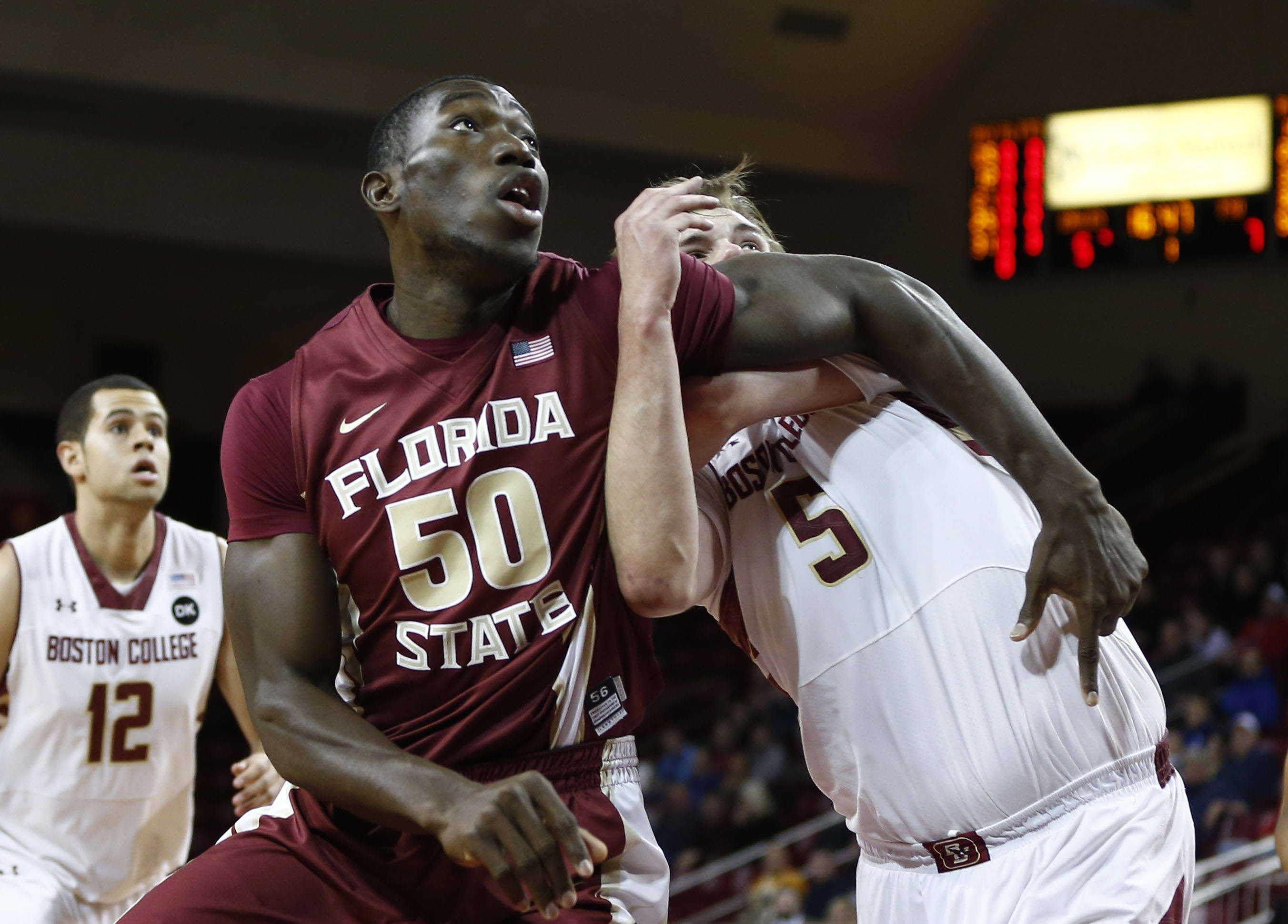 Mar 4, 2014; Chestnut Hill, MA, USA; Seminoles center Michael Ojo (50) blocks out against Boston College Eagles center KC Caudill (5) during the first half. Mark L. Baer-USA TODAY Sports