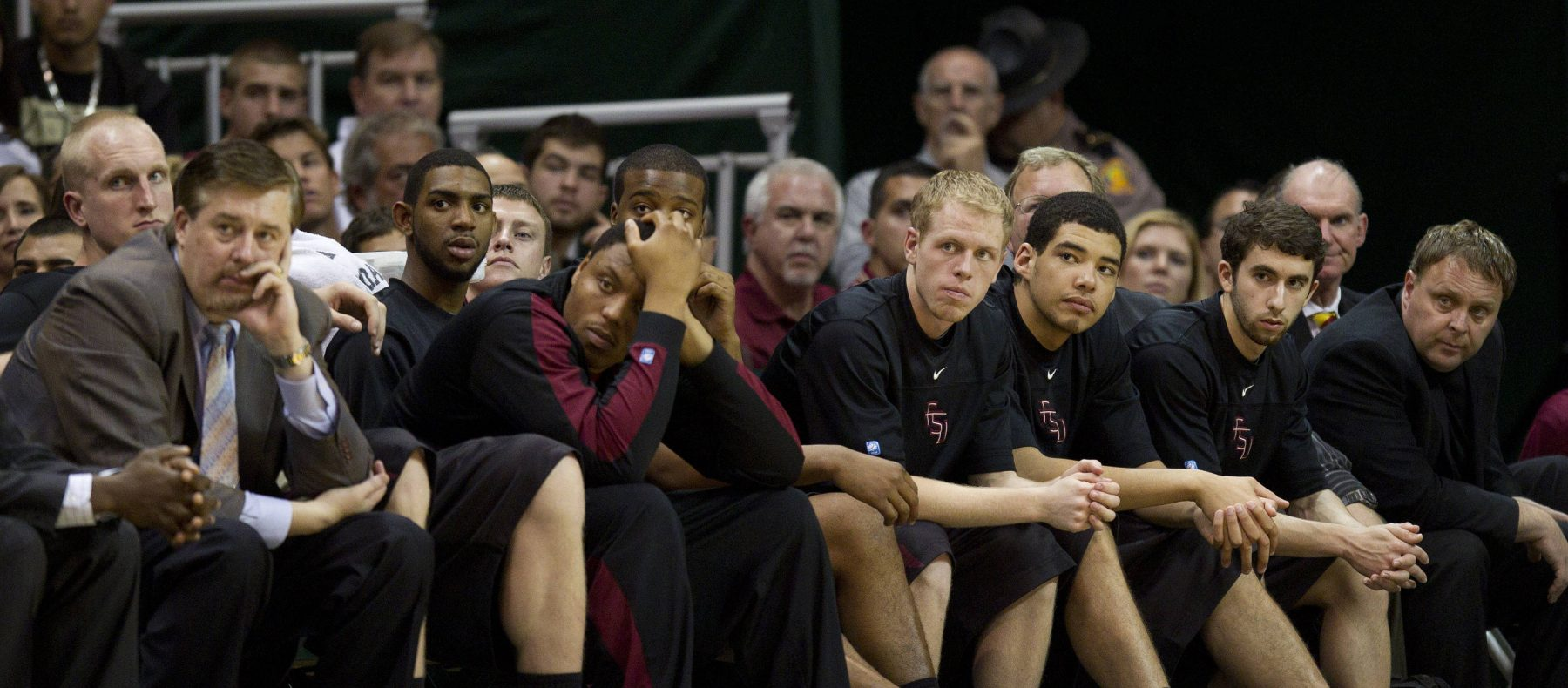 The Florida State bench watches as Miami scores two points during the second half of an NCAA college basketball game in Coral Gables, Fla., Sunday, Feb. 26, 2012. Miami defeated Florida State 78-62. (AP Photo/J Pat Carter)