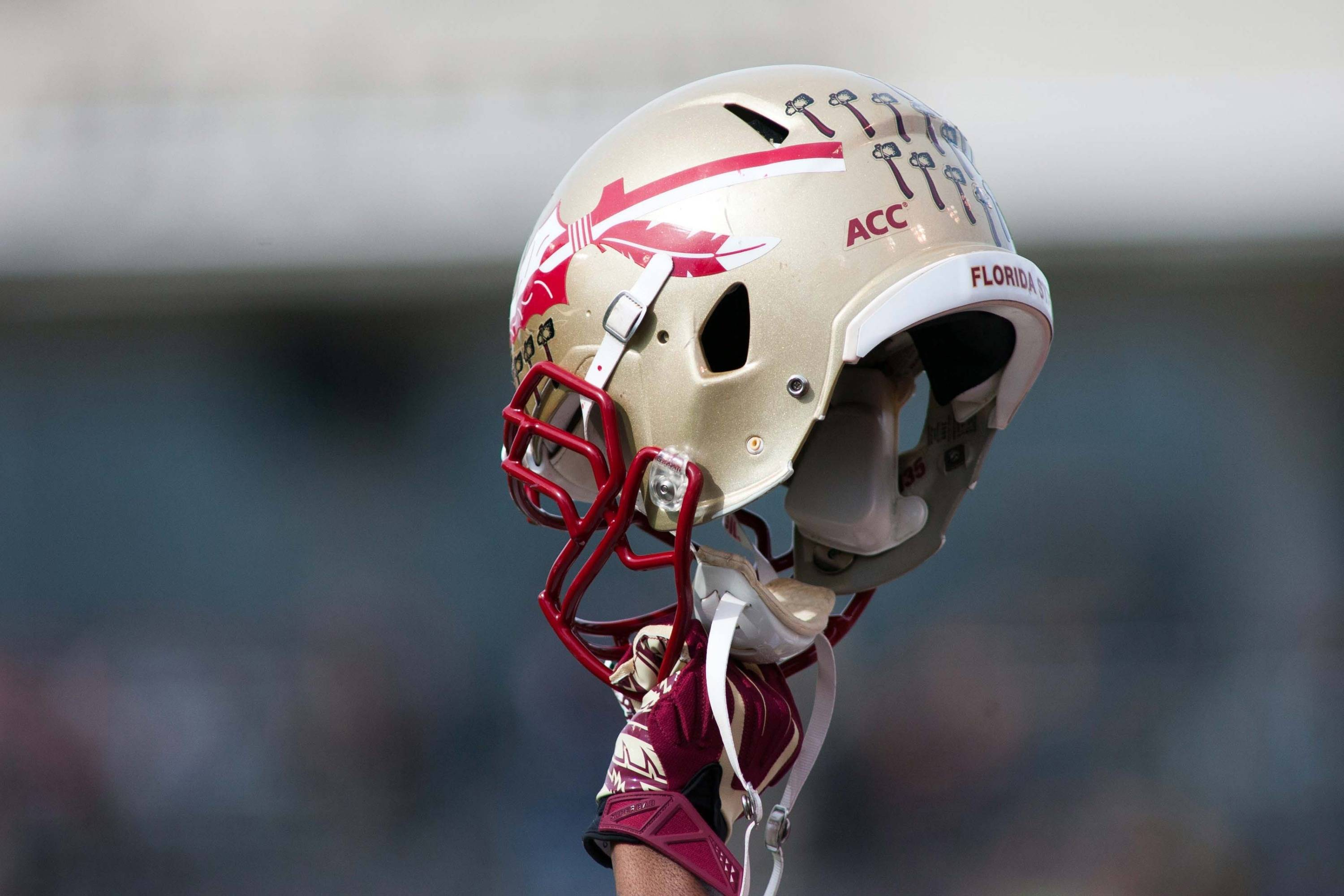 A Florida State Seminoles player holds up a helmet prior to kickoff. Mandatory Credit: Jeremy Brevard-USA TODAY Sports