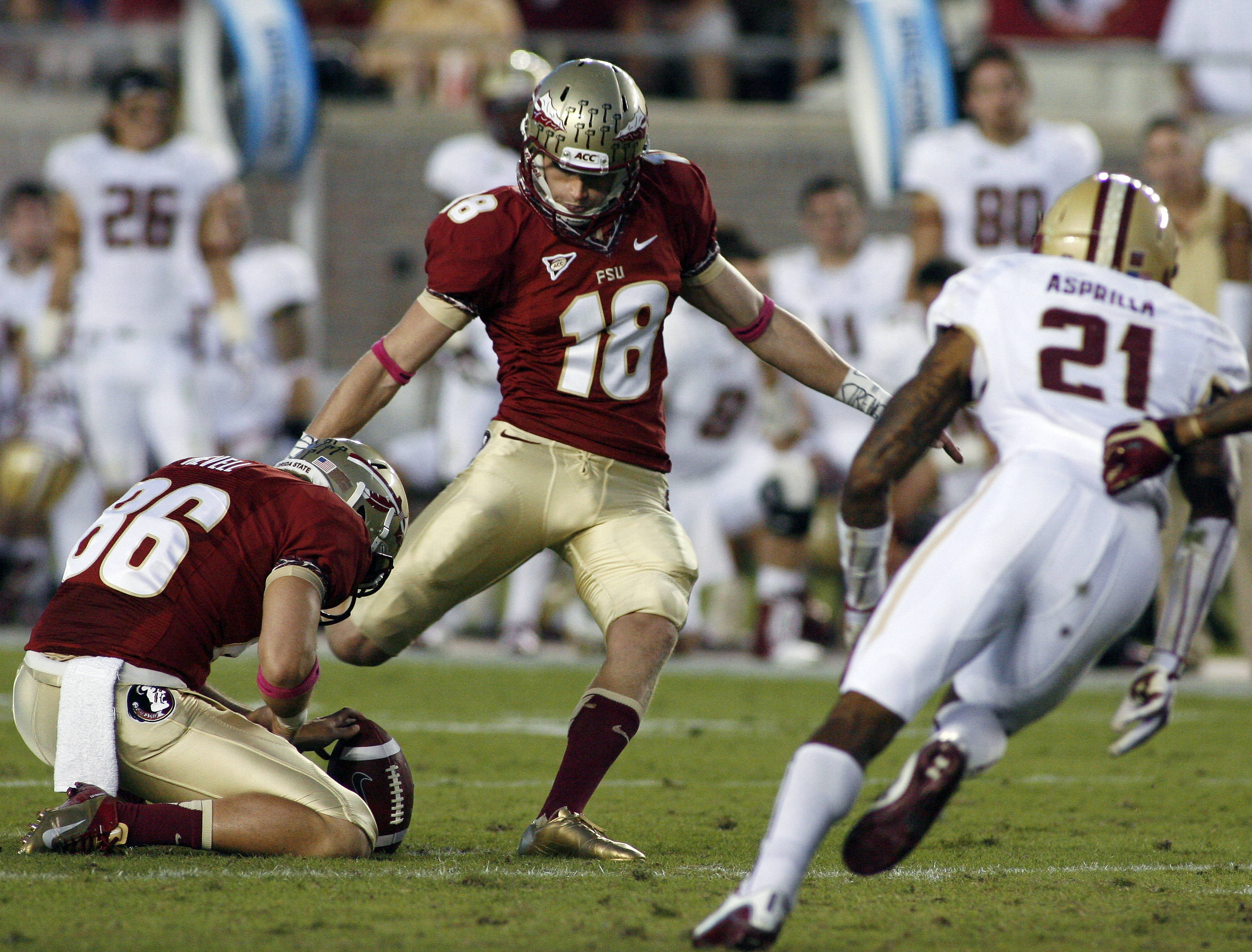 With Florida State holder Chris Revell (86) holding the ball, kicker Dustin Hopkins (18) makes a 51-yard field goal at the end of the second quarter. (AP Photo/Phil Sears)
