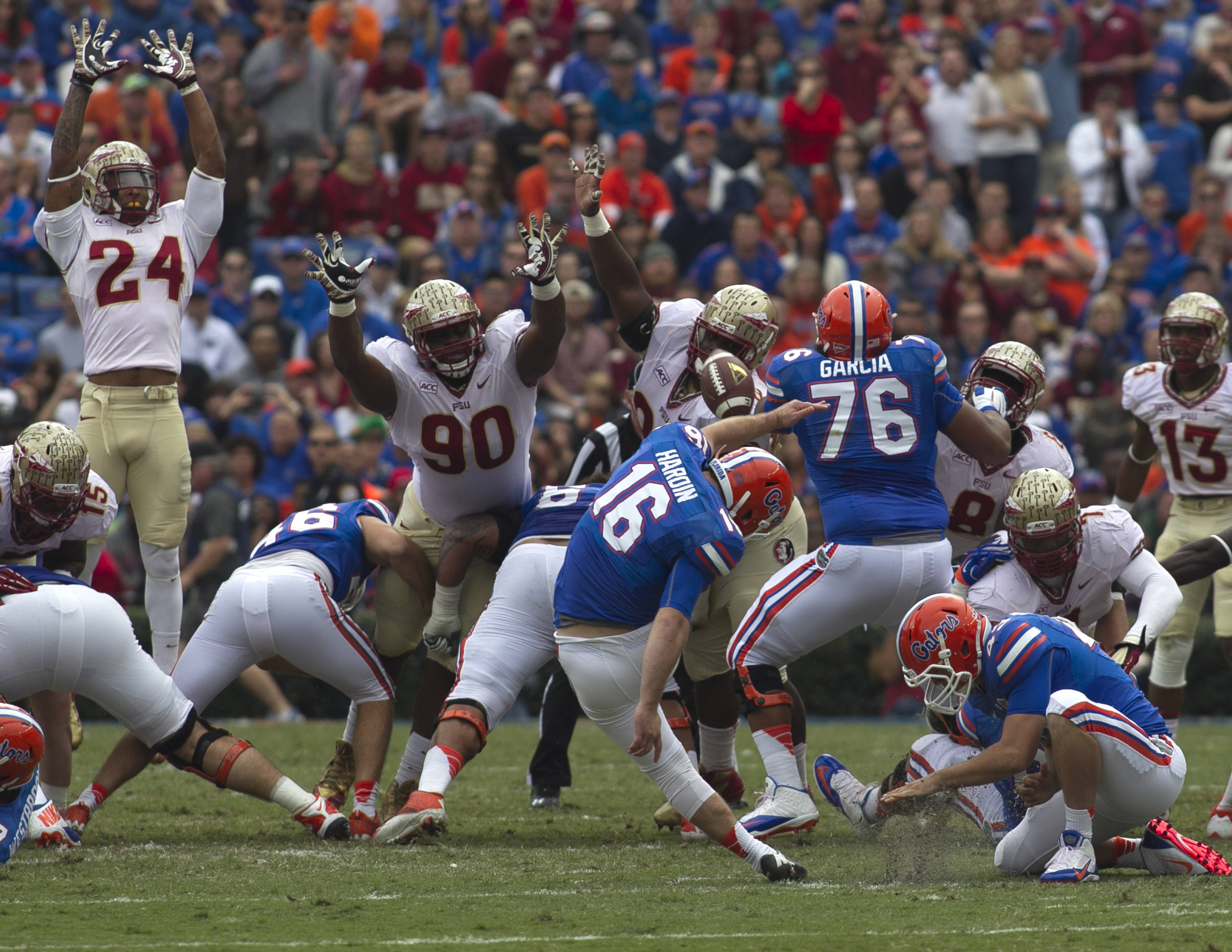 Terrance Smith (90) and Eddie Goldman (90), with a defensive effort contributing to a missed Gator field goal, FSU vs Florida, 11-30-13,  (Photo by Steve Musco)
