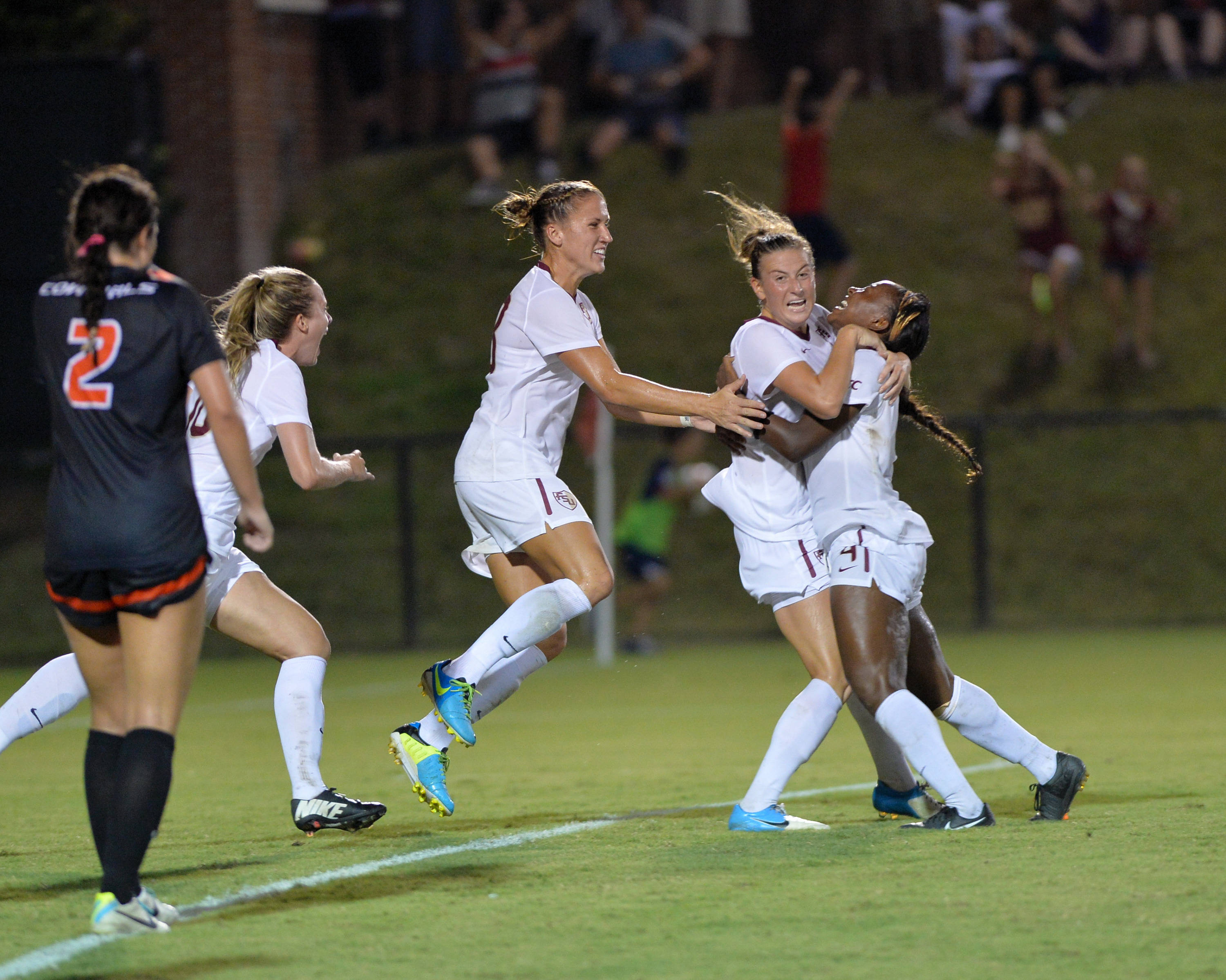 The Seminoles celebrate after Jamia Fields scores the game-tying goal with a minute and nine seconds left in regulation.