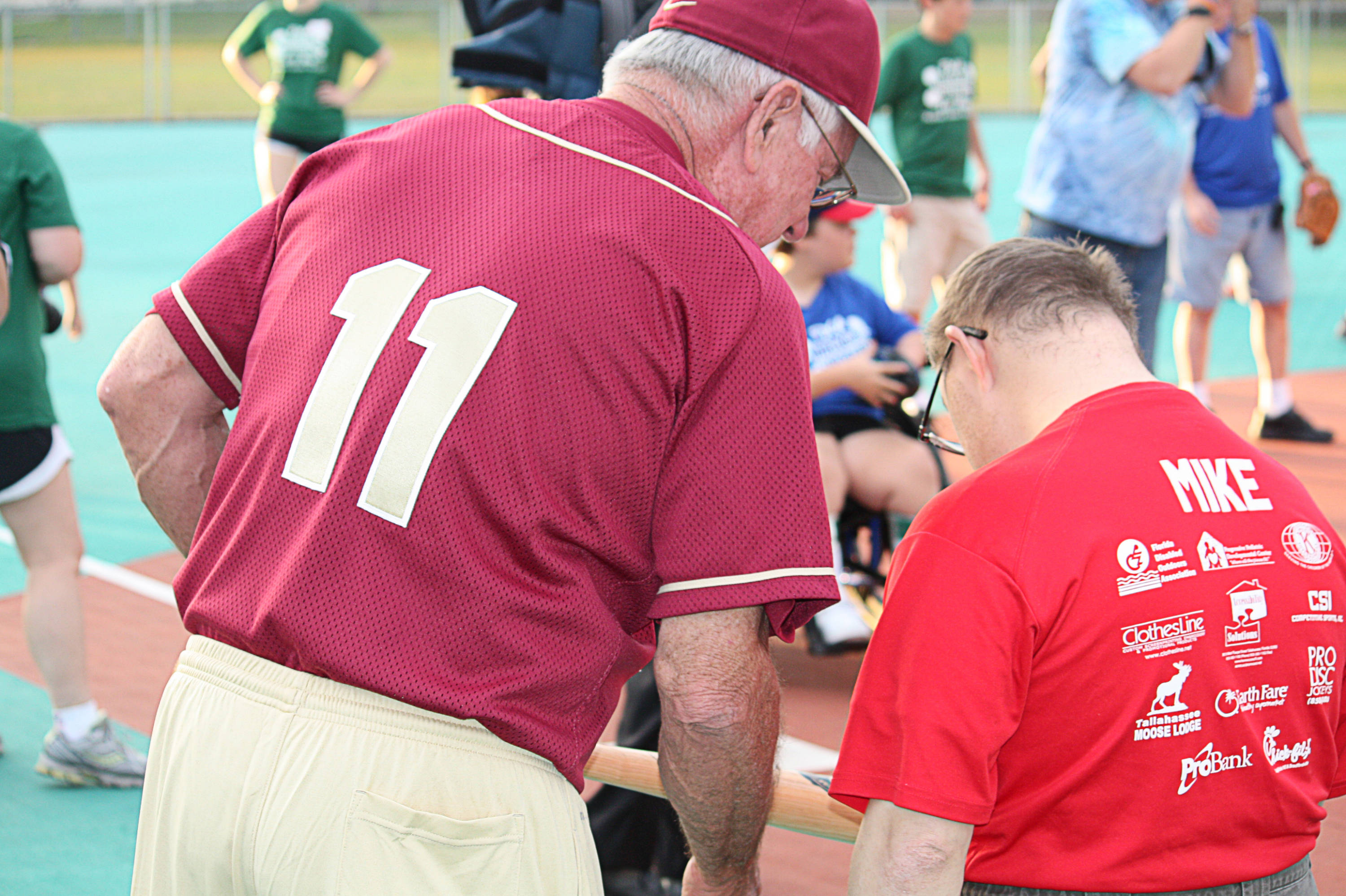 Mike Martin (11) gives Mike Martin a signed bat