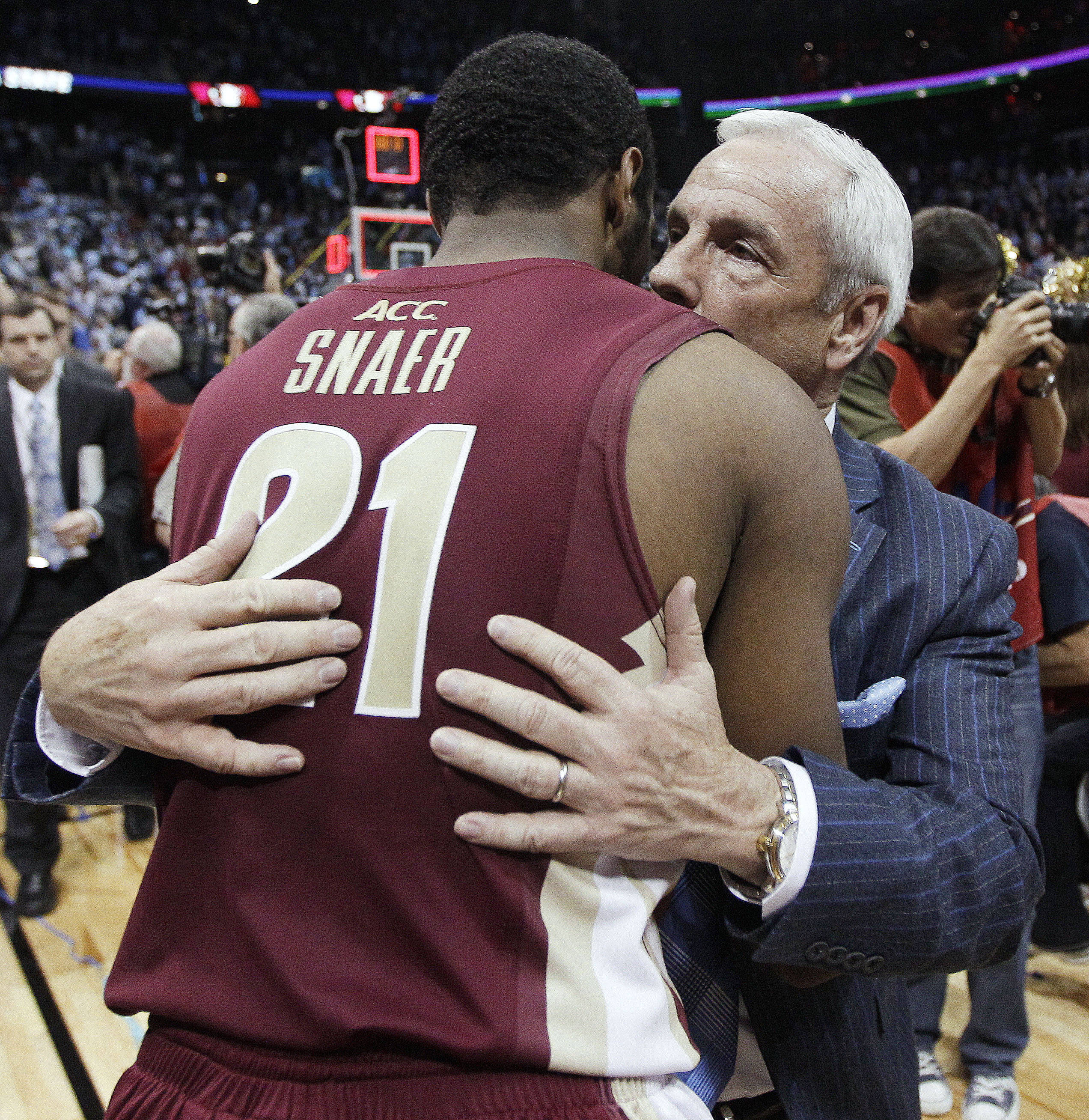 North Carolina coach Roy Williams embraces Michael Snaer. (AP Photo/Chuck Burton)