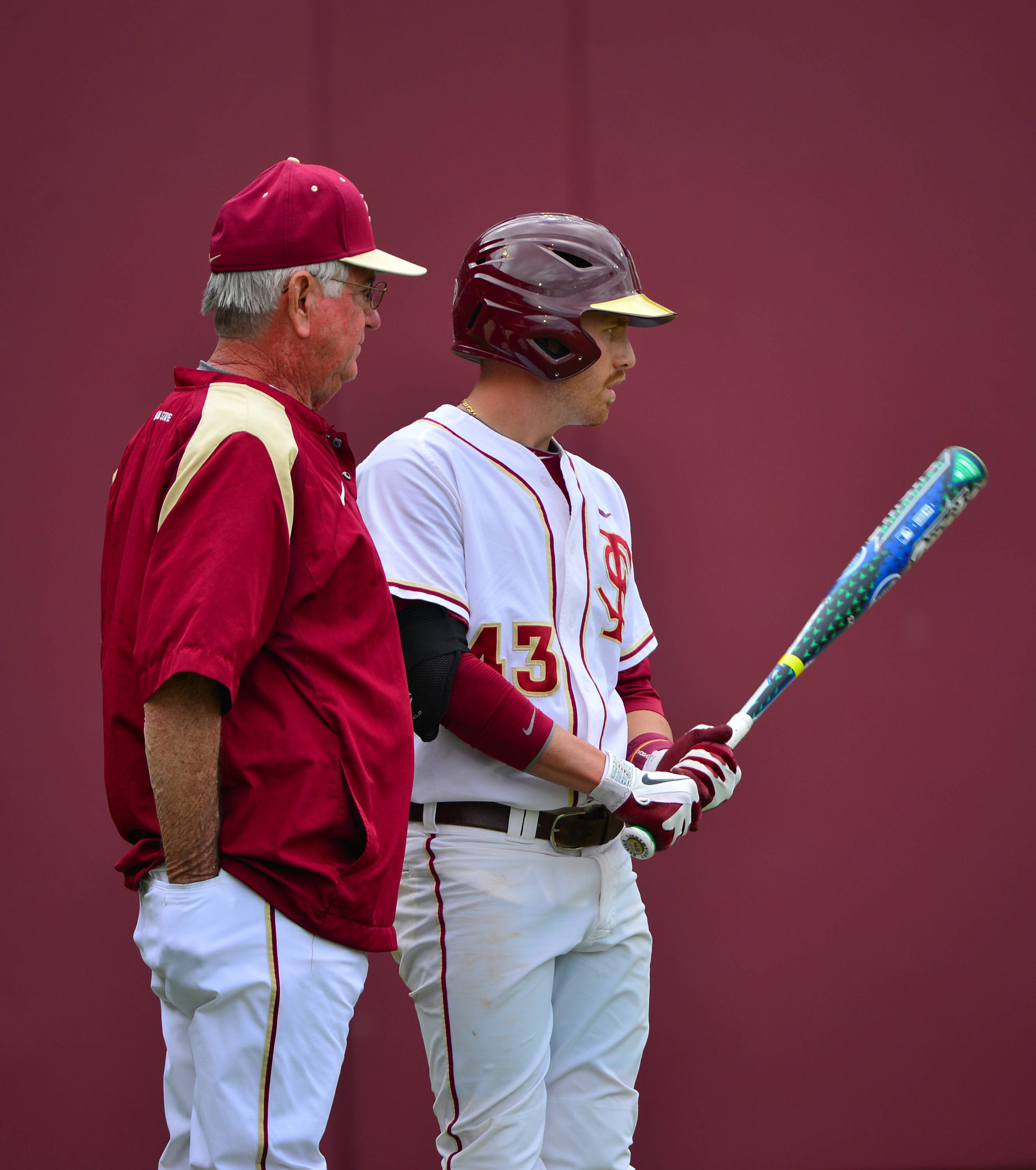 Head coach Mike Martin speaks with Casey Smit.