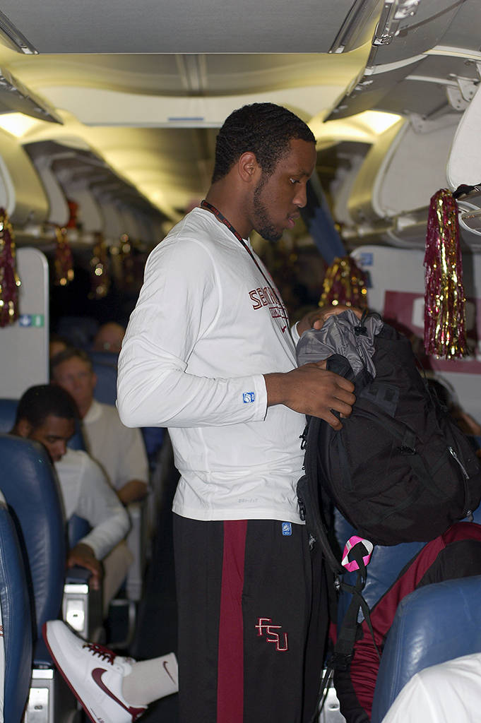 Michael Snaer took time out from his busy schedule of draining 3-pointers to stow his backpack.