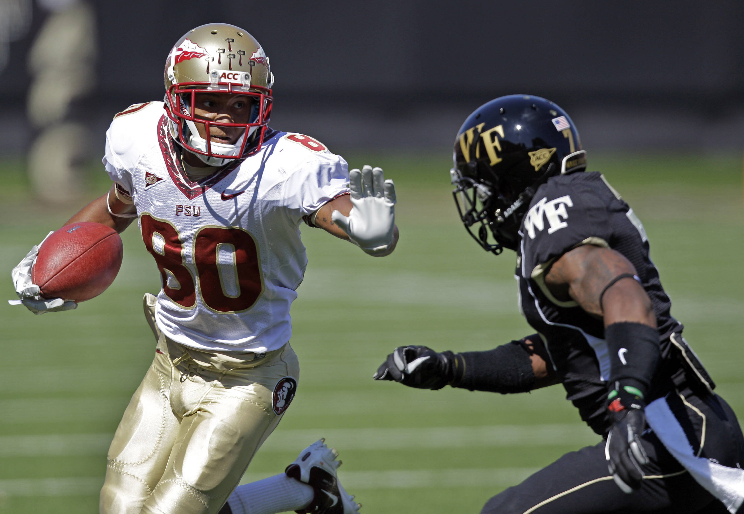 Florida State's Rashad Greene, left, tries to run past Wake Forest's Merrill Noel, right, in the first half of a NCAA college football game in Winston-Salem, N.C., Saturday, Oct. 8, 2011. (AP Photo/Chuck Burton)