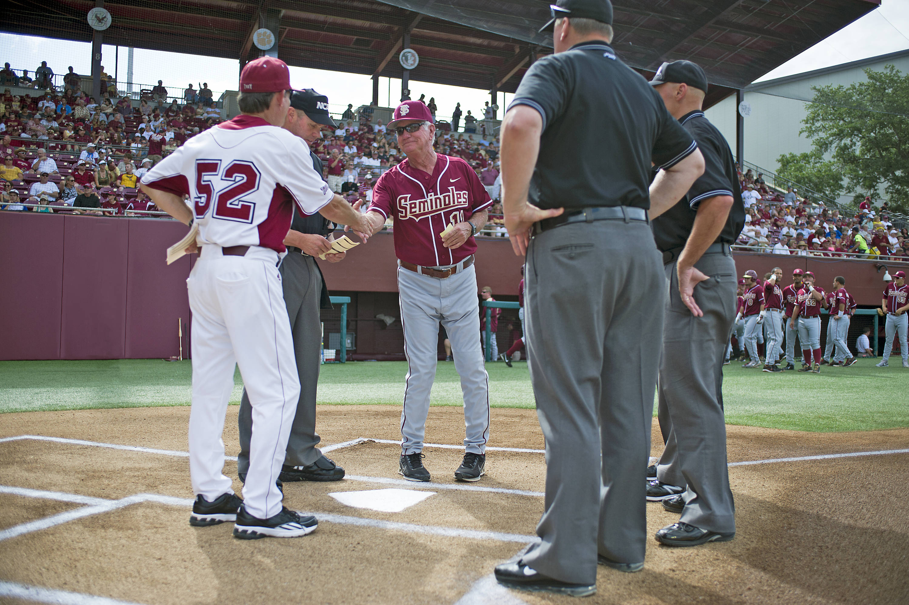Mike Martin (11) shakes hands with Troy's coach after exchanging line ups