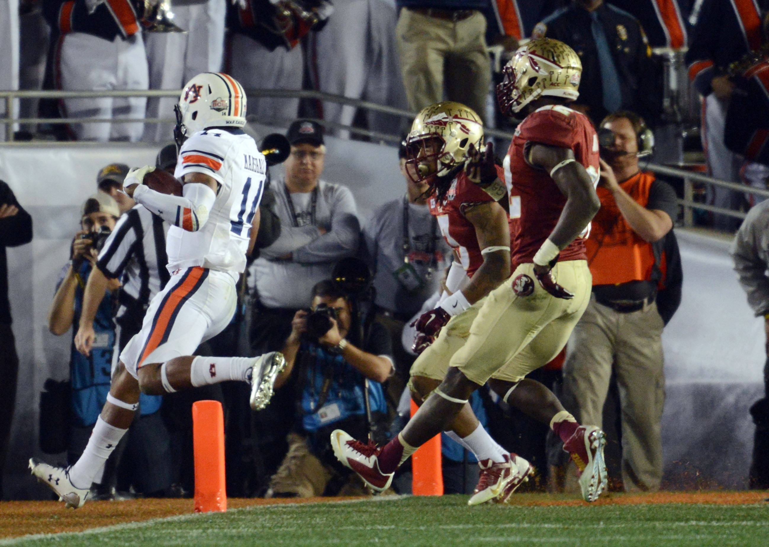 Jan 6, 2014; Pasadena, CA, USA; Auburn Tigers quarterback Nick Marshall (14) scores a touchdown against the Florida State Seminoles during the first half of the 2014 BCS National Championship game at the Rose Bowl.  Mandatory Credit: Jayne Kamin-Oncea-USA TODAY Sports