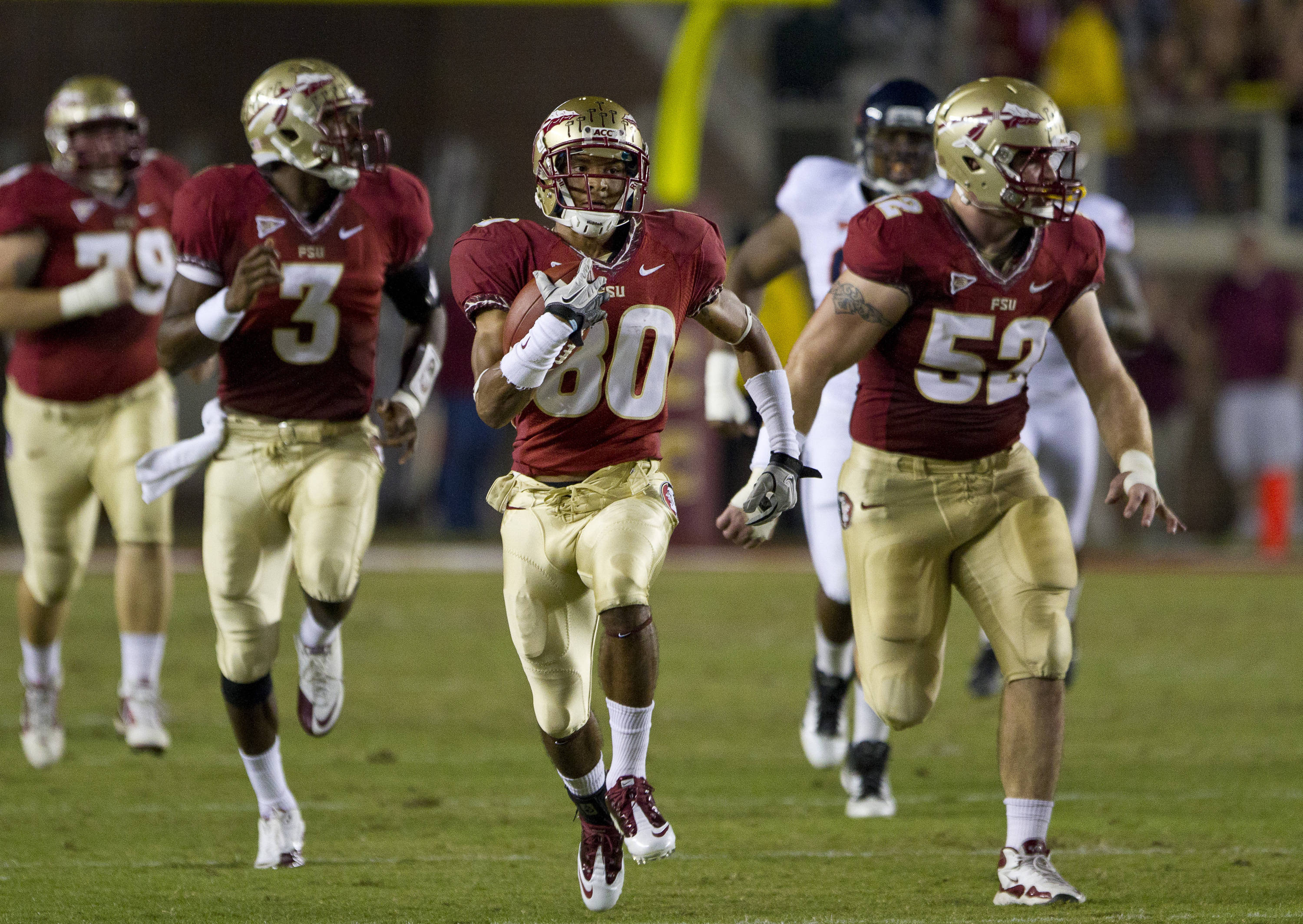 Rashad Greene (80) carries the ball down the field during the game against Virginia on November 19, 2011.