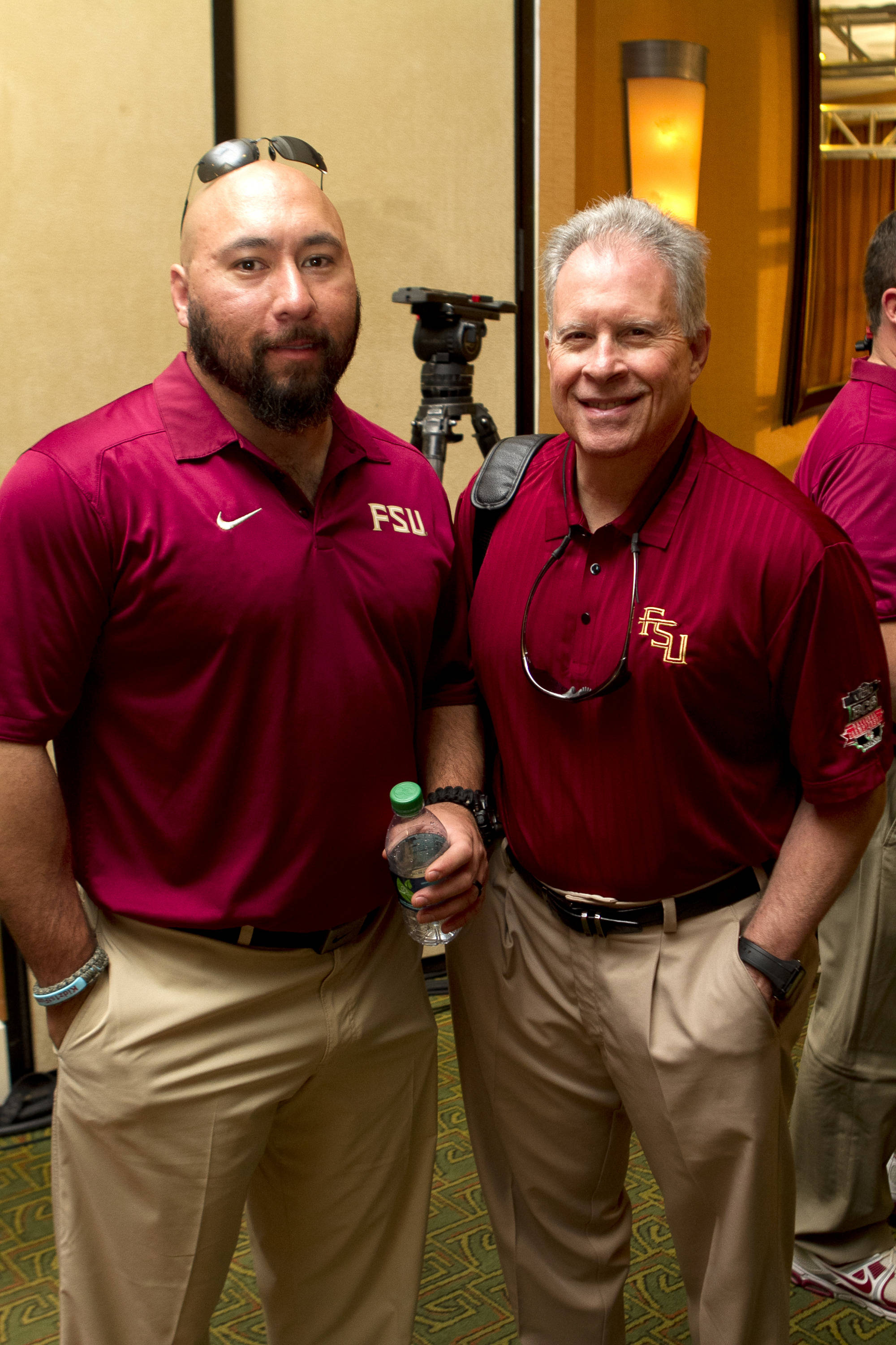 Strength and Conditioning Coach Vic Viloria and Director of Player Personnel Bob Lacivita, FSU at BCS Championship Media Day,  1-04-14,  (Photo by Steve Musco)