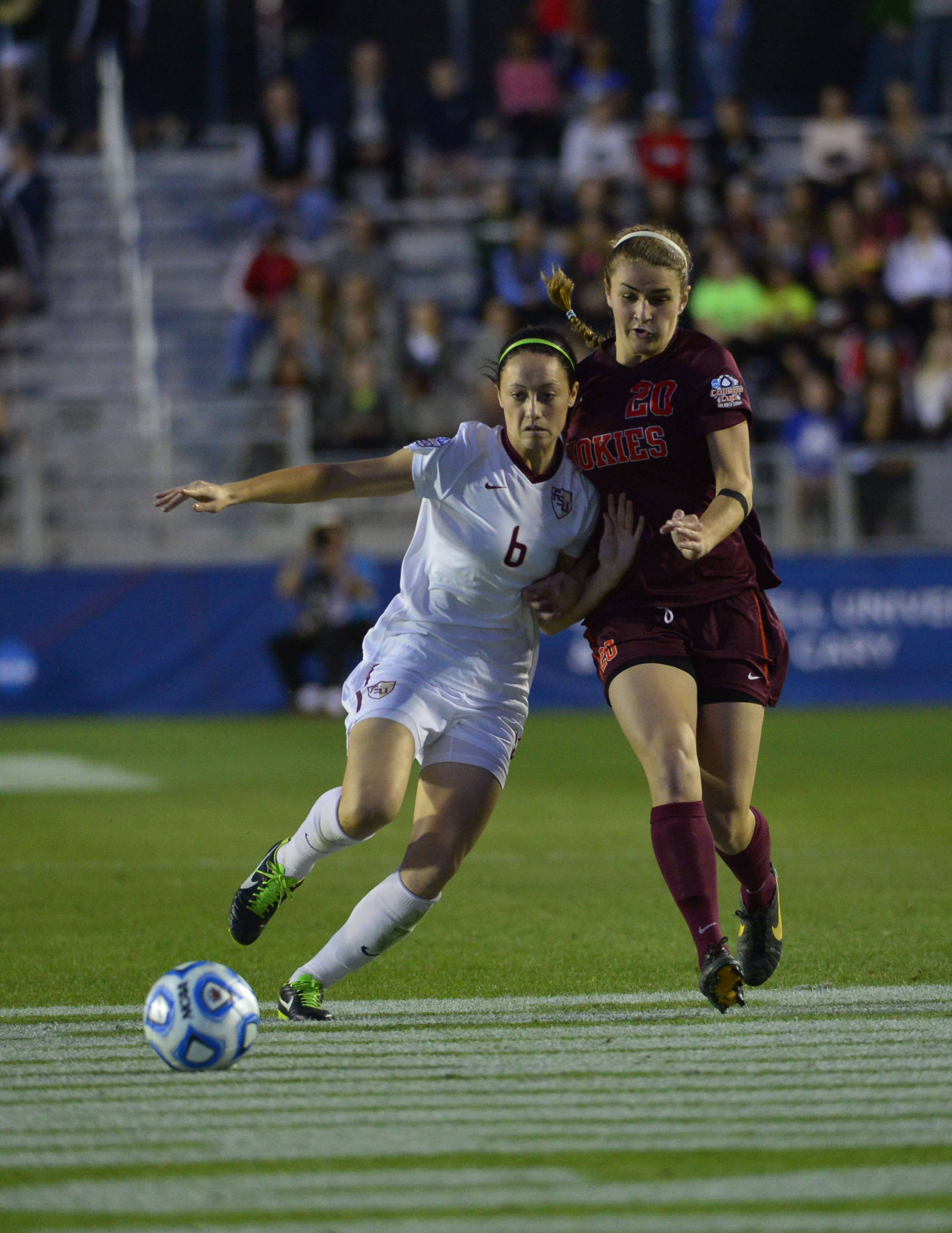 Dec 6, 2013; Cary, NC, USA; Florida State Seminoles defender Megan Campbell (6) fights for the ball with Virginia Tech Hokies forward Murielle Tiernan (20) in the first half at WakeMed Soccer Park. Mandatory Credit: Bob Donnan-USA TODAY Sports