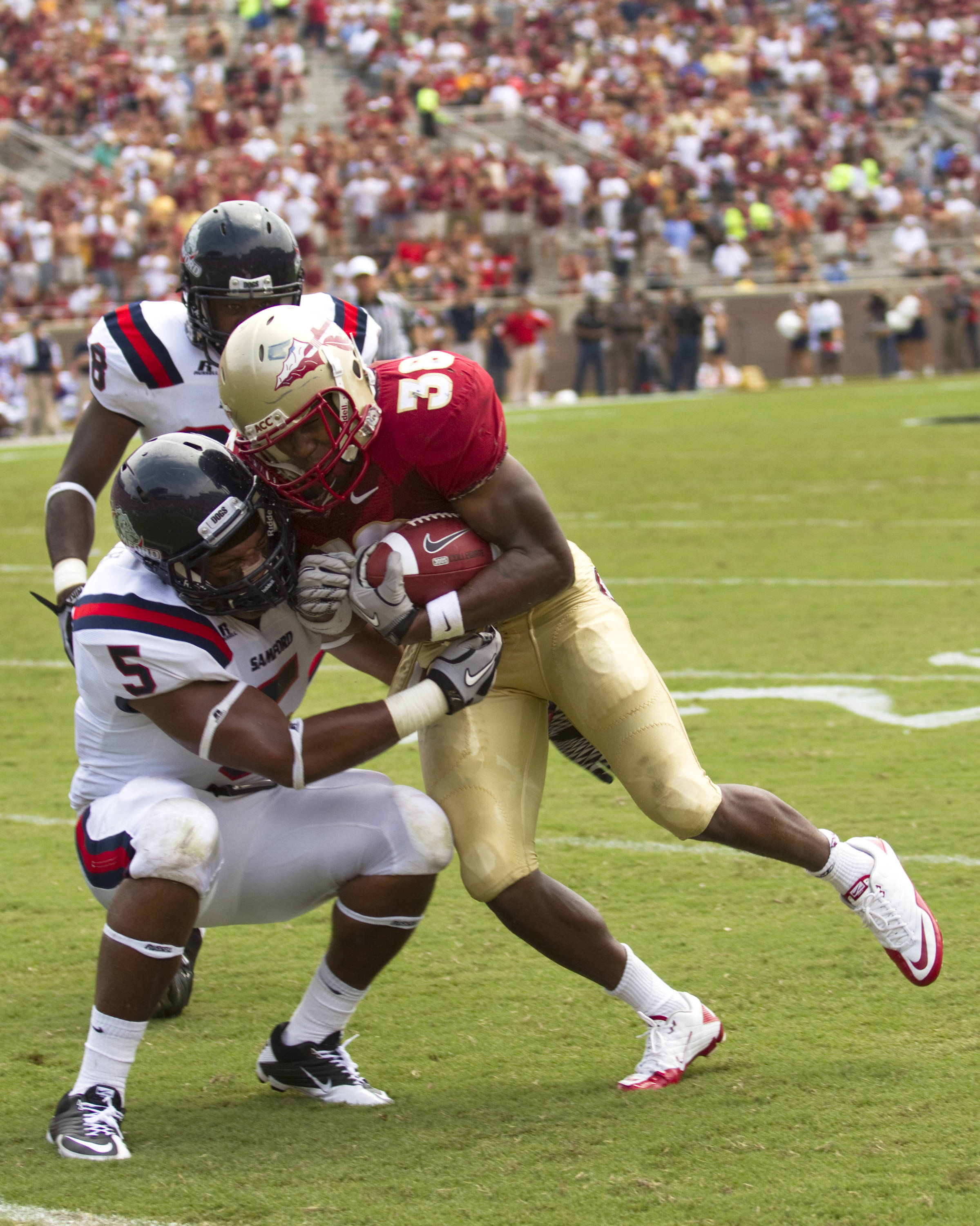 Darren Edwards (38) blocks a tackle from Samford's number 5.