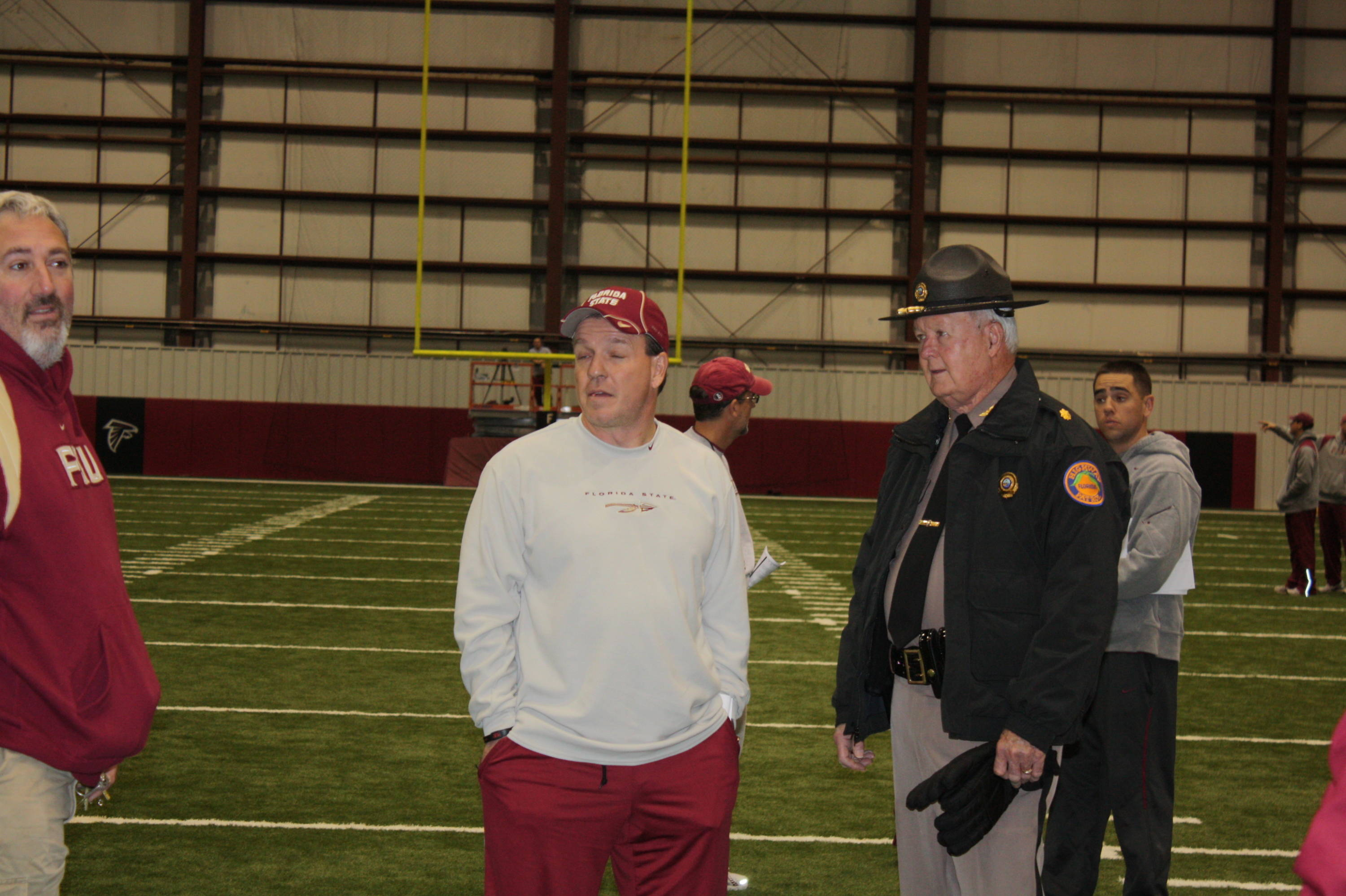 Jimbo Fisher, Craig Campanozzi and Maj. Billy Smith look around the facility.