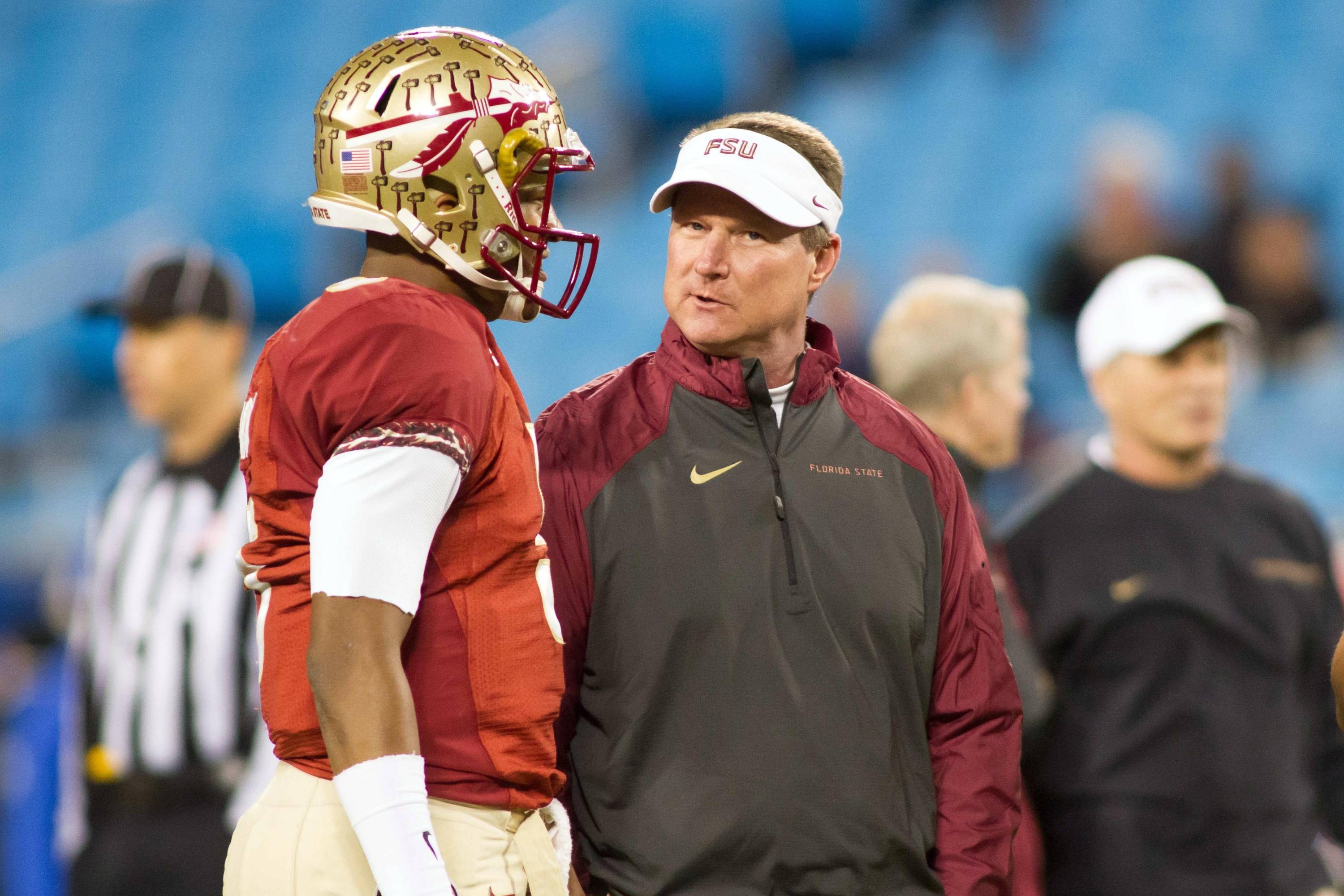 Dec 7, 2013; Charlotte, NC, USA; Florida State Seminoles quarterback Jameis Winston (5) talks with quarterback coach Randy Sanders before the start of the game against the Duke Blue Devils at Bank of America Stadium. Mandatory Credit: Jeremy Brevard-USA TODAY Sports