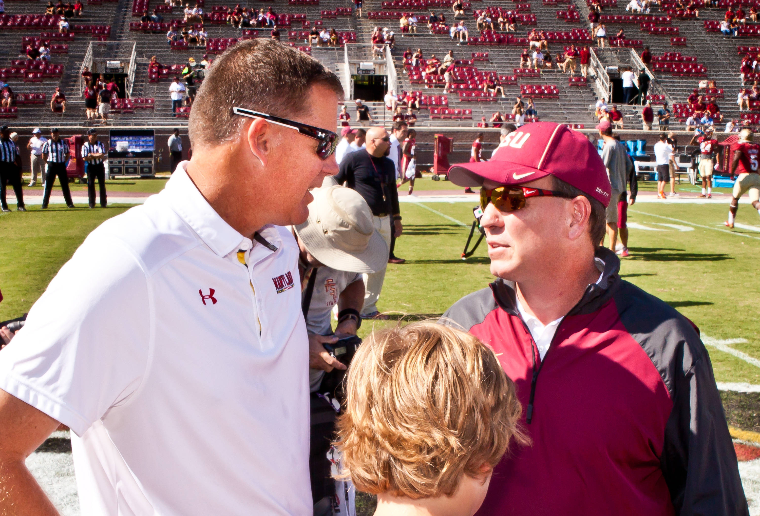 Randy Edsall and Jimbo Fisher meet before the game.