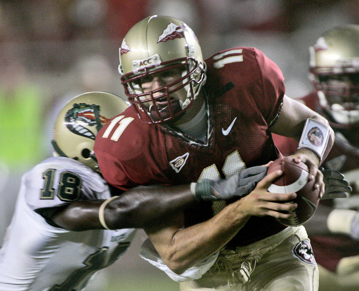 Florida State quarterback Drew Weatherford, right, runs for third-quarter yardage as UAB defender Will Dunbar, left, moves in to make the tackle during a football game Saturday, Sept. 8, 2007, in Tallahassee, Fla. Florida State won 34-24. (AP Photo/Phil Coale)