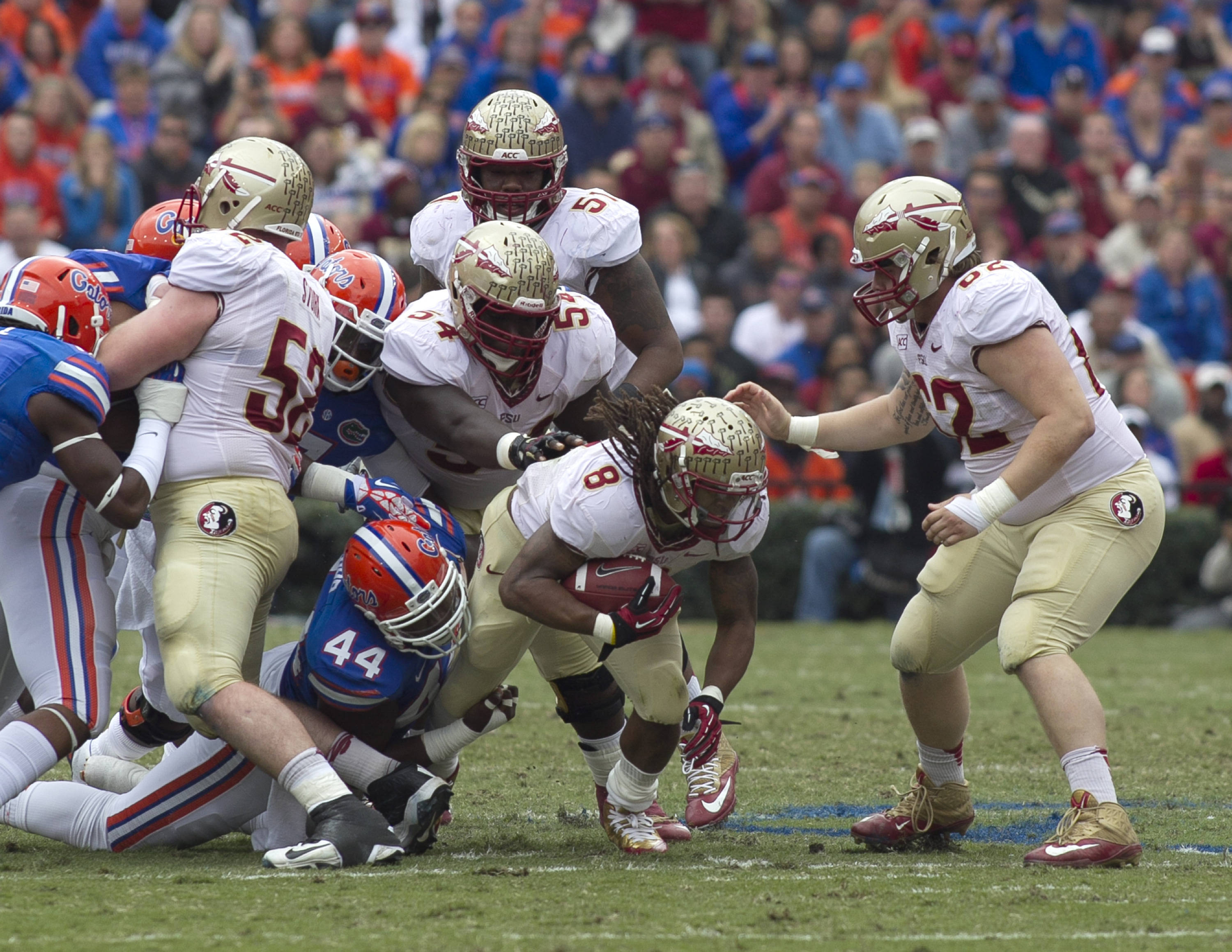 Devonta Freeman (8) with hard earned running yards, FSU vs Florida, 11-30-13,  (Photo by Steve Musco)