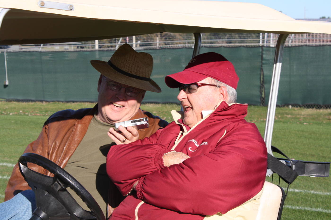 Coach Bowden does an interview in his golf cart before practice