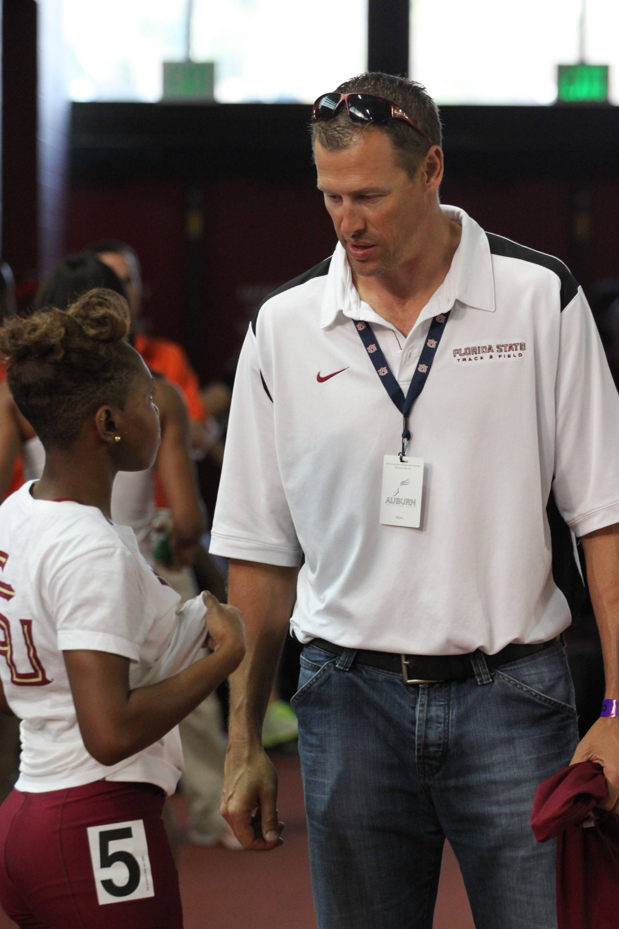 Director of Sprints, Hurdles and Relays Ken Harnden has a word with freshman Jande Pierce before her FSU debut in the 400 meters.