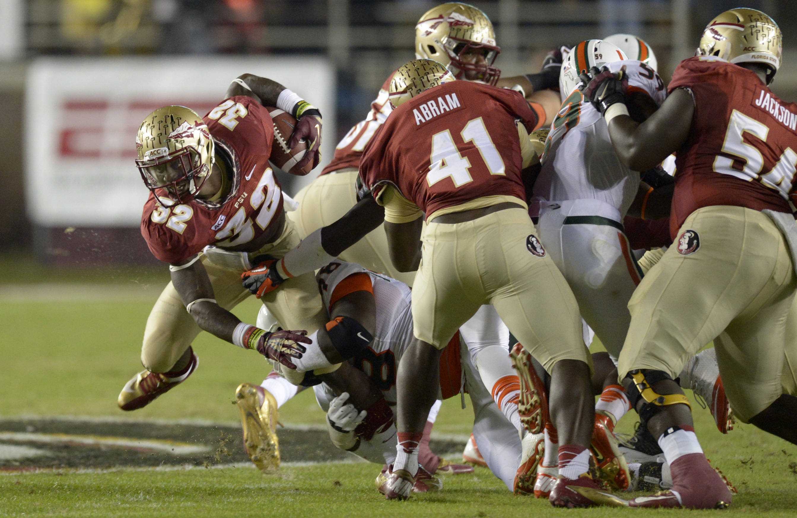 Florida State Seminoles running back James Wilder Jr. (32) carries the ball against the Miami Hurricanes during the first quarter at Doak Campbell Stadium. Mandatory Credit: John David Mercer-USA TODAY Sports
